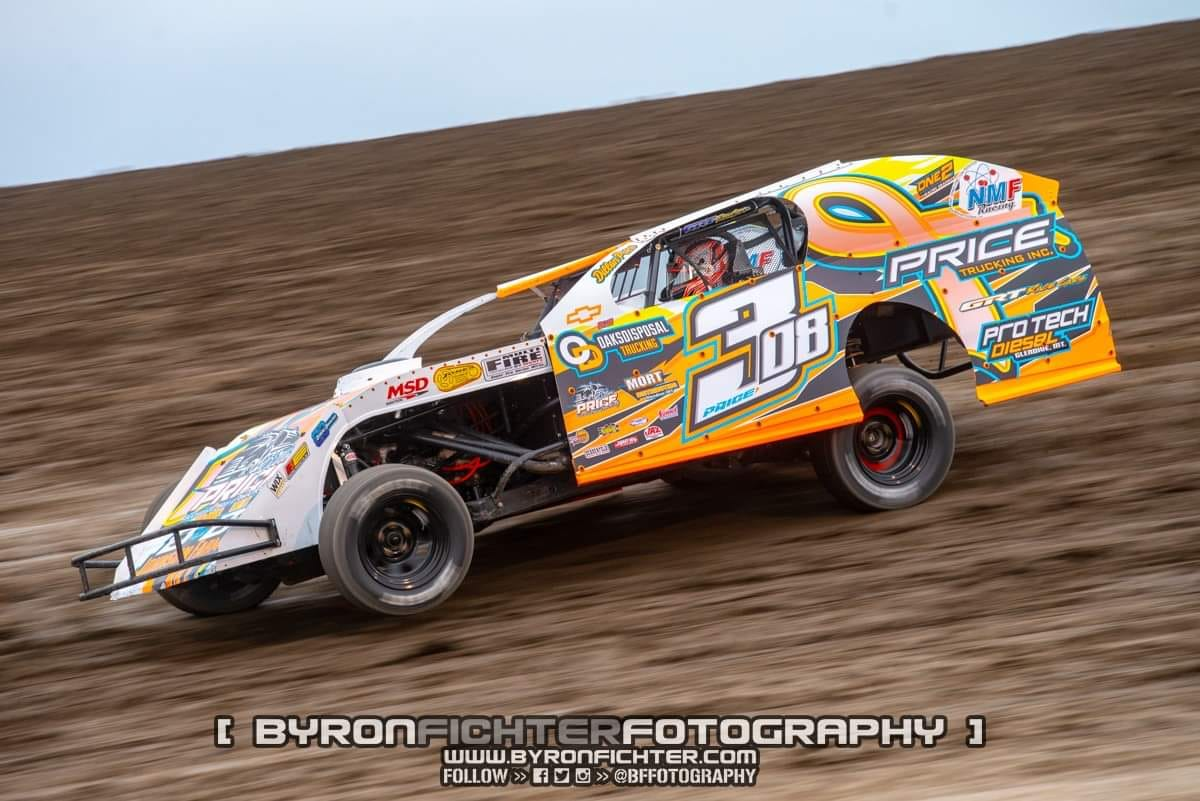 Dillon Price taking it to the track at Estevan Motor Speedway in Saskatchewan.  Your new wrap is looking awesome, Dillon.jpg