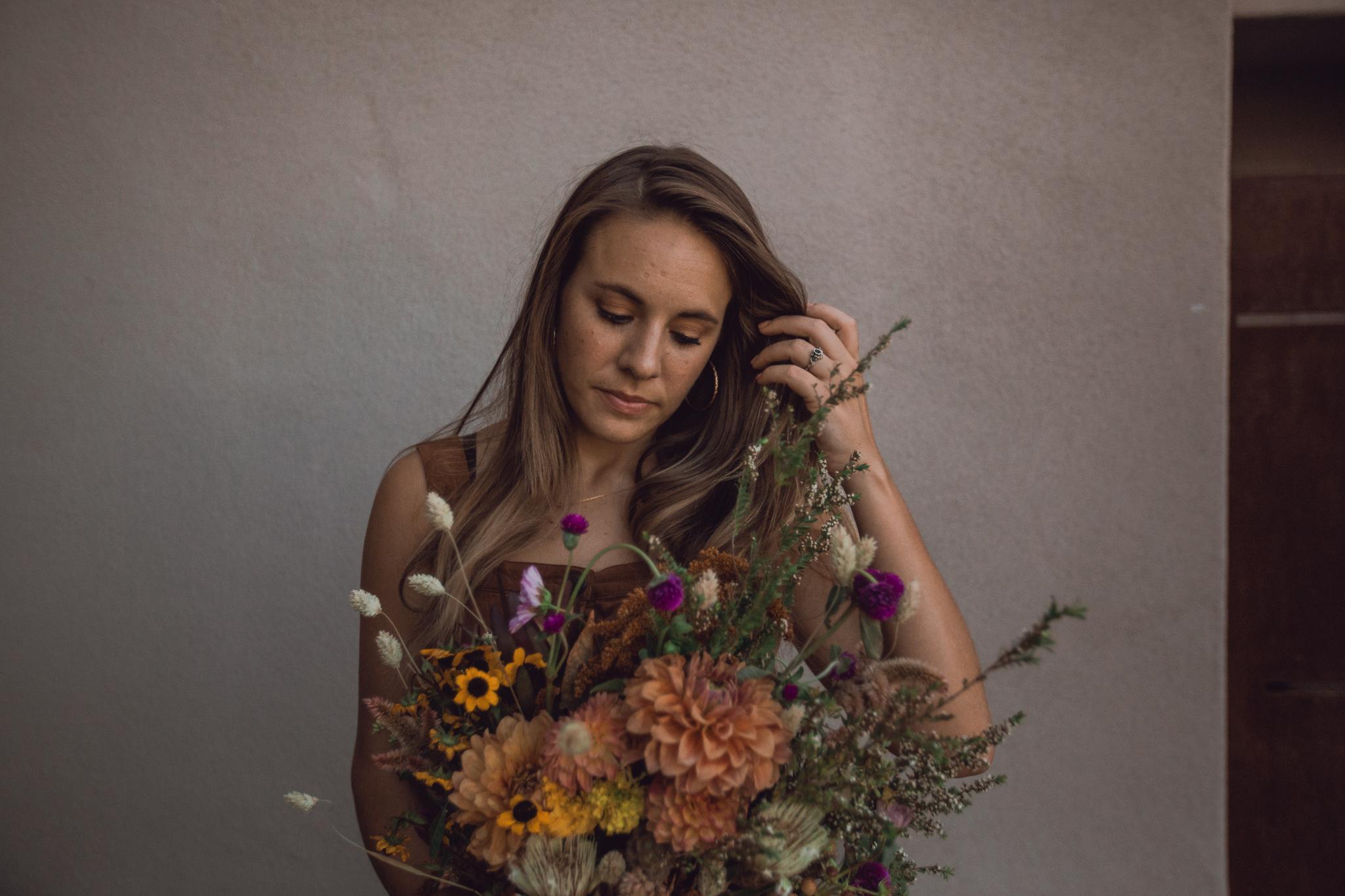 dark-moody-portrait-with-flowers