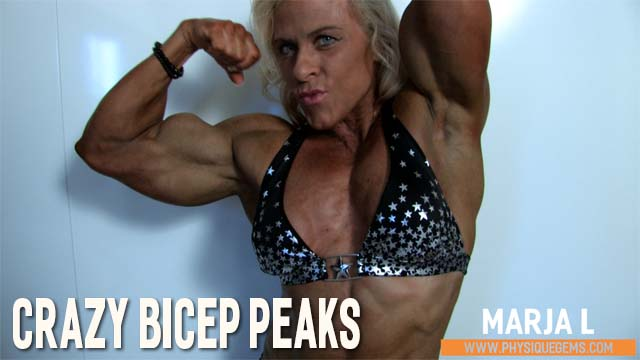 Crazy Bicep Peaks - Wearing a black bikini Marja's upper body is shown to the fullest. Those crazy biceps are the focus here. [6:59 minutes]