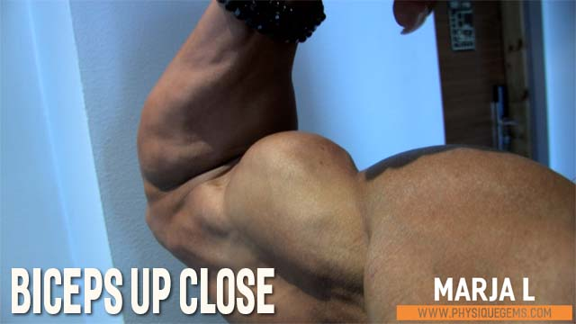Biceps Up Close - Marja is getting seriously pumped up from all the flexing. Amazing up close angles of her ridiculous peaks! [4:46 minutes]