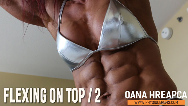 Flexing On Top part 2 - Seriously beautiful view of Oana's washboard abs and dense pecs. Contest shape muscle in an up close setting. [4:05 minutes]