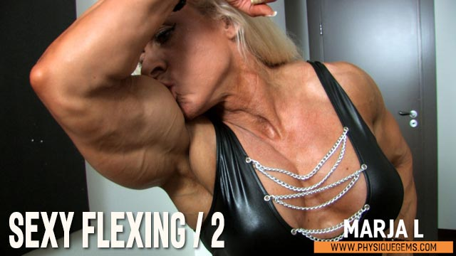 Sexy Flexing part 2 - Sexy flexing in the black outfit continues! Marja kisses her huge biceps and moves to the floor to give you a great flexing angle.