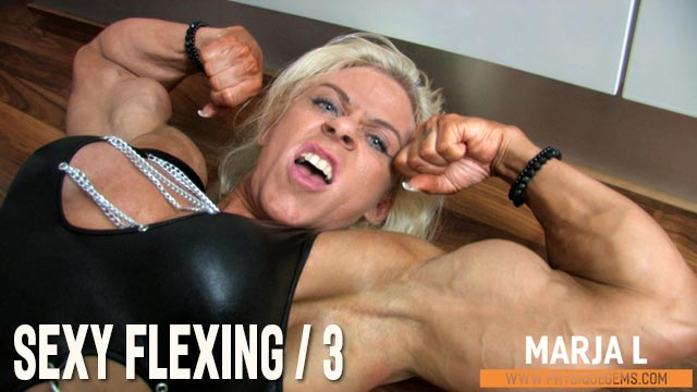 Sexy Flexing part 3 - More sexy flexing in black! Amazing angles of her peaked biceps and dense pecs as she gives a non stop sensual flexing show.