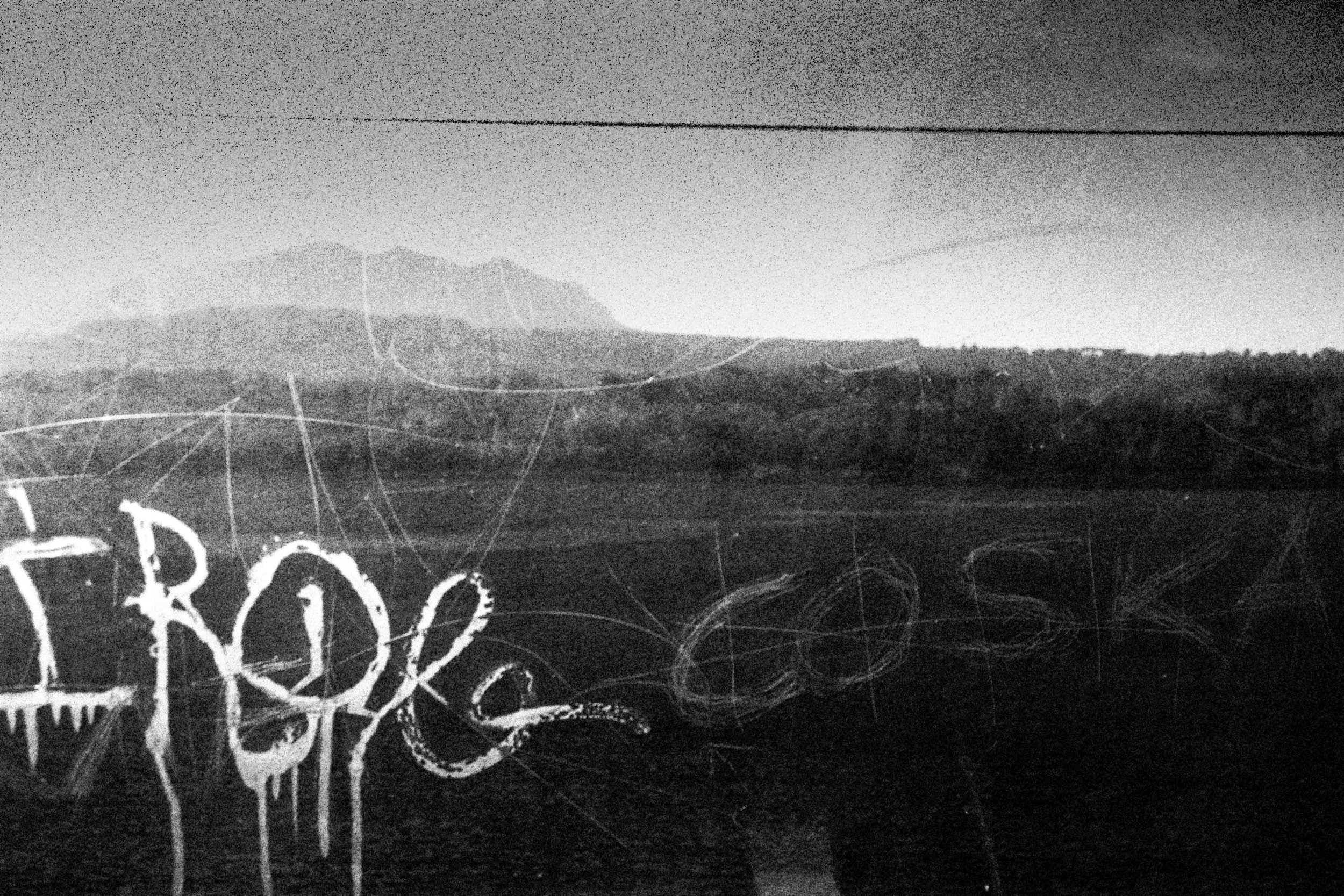 View from a train window. If they can afford to, refugees buy train tickets through Italy to cities like Berlin and Paris. However, since the closing of borders to refugees, trains are too visible and a people risk being detained.