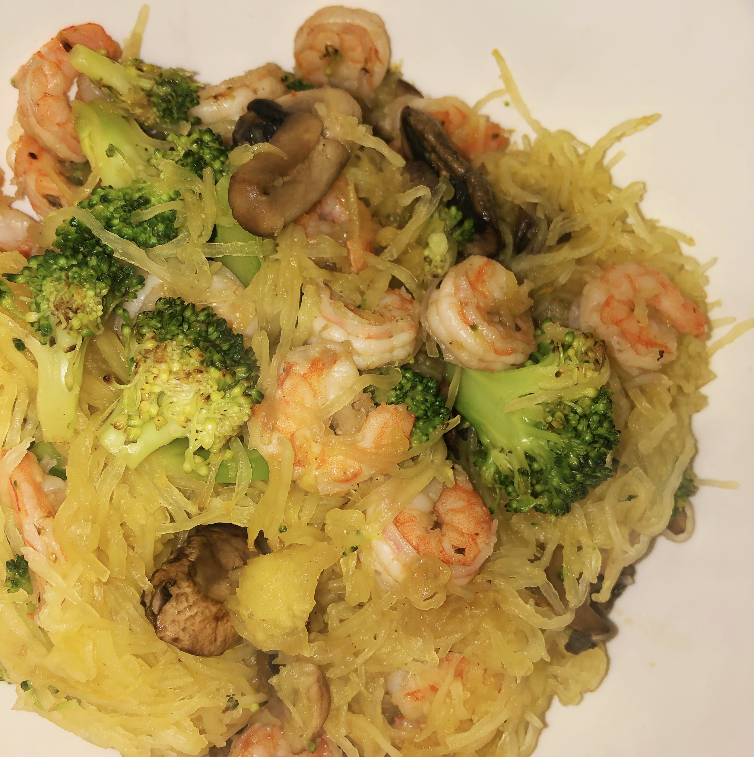 Dinner: Shrimp, broccoli, mushrooms, and spaghetti squash - 7019238/10 would eat this meal again, and yes I just typed in some random number there. It has mushrooms in it though, and I'm a sucker for mushrooms.