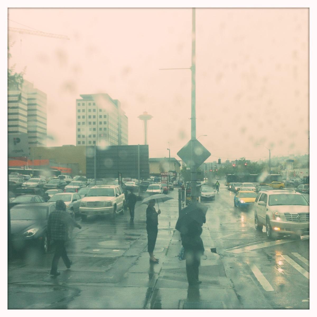 Orange Space Needle through a rain splashed window on the SLUT.   Adler 9009 Lens, Blanko Film, No Flash, Taken with  Hipstamatic