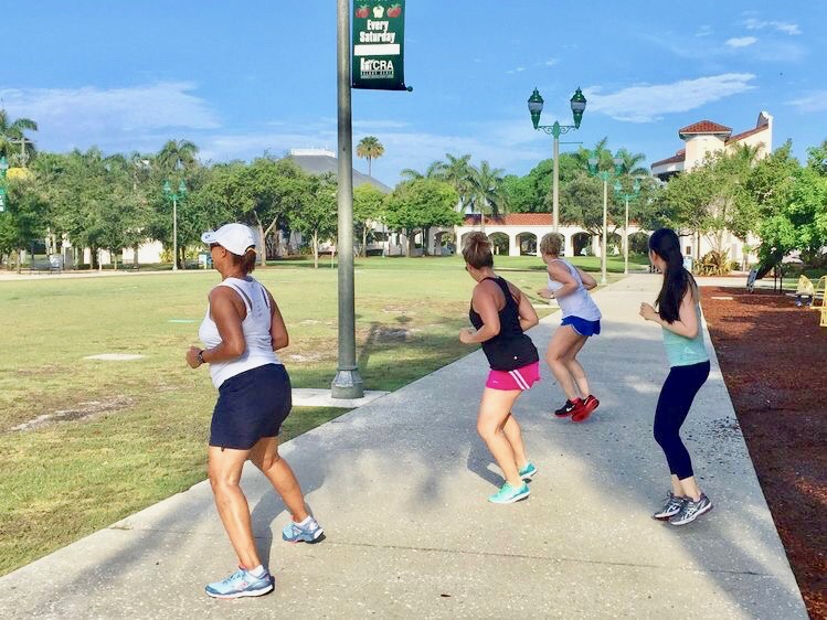 Guests side shuffle during morning cardio workout at the park.