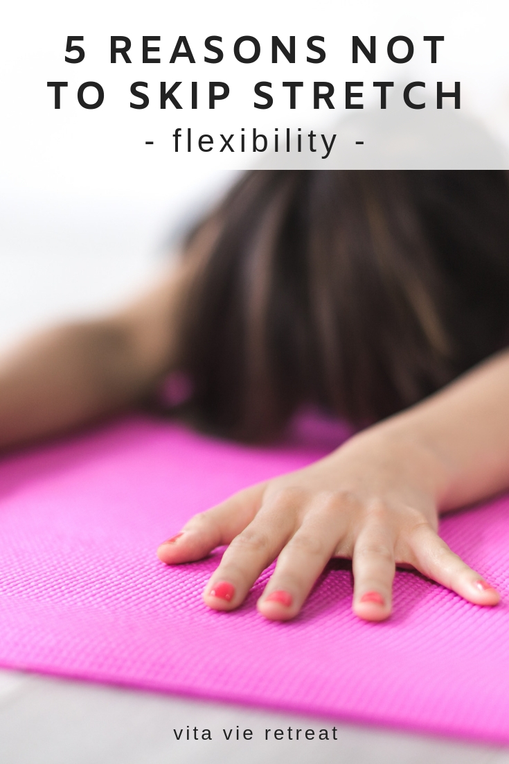 Woman not skipping flexibility by stretching on mat.