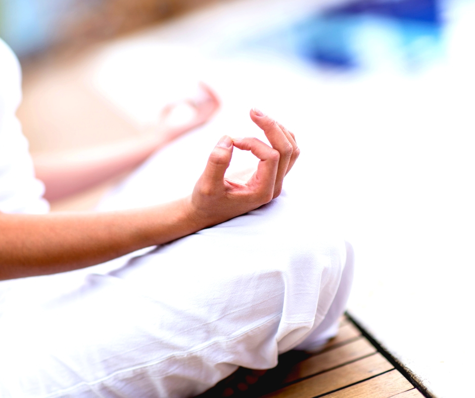 Woman deep breathing to help reduce stress.