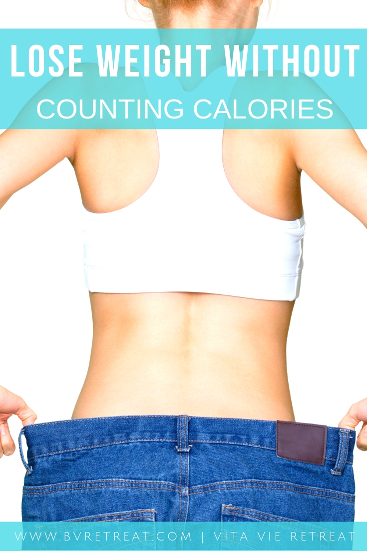 Woman showing weight loss without counting calories.