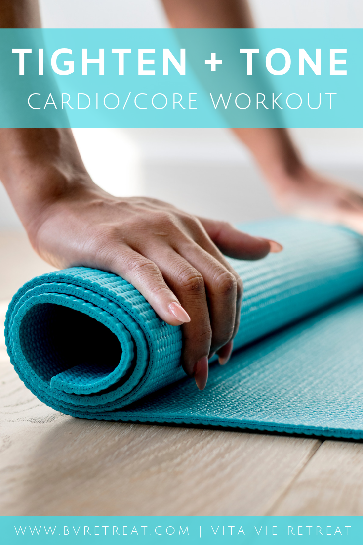 Woman getting a mat for her cardio core workout.