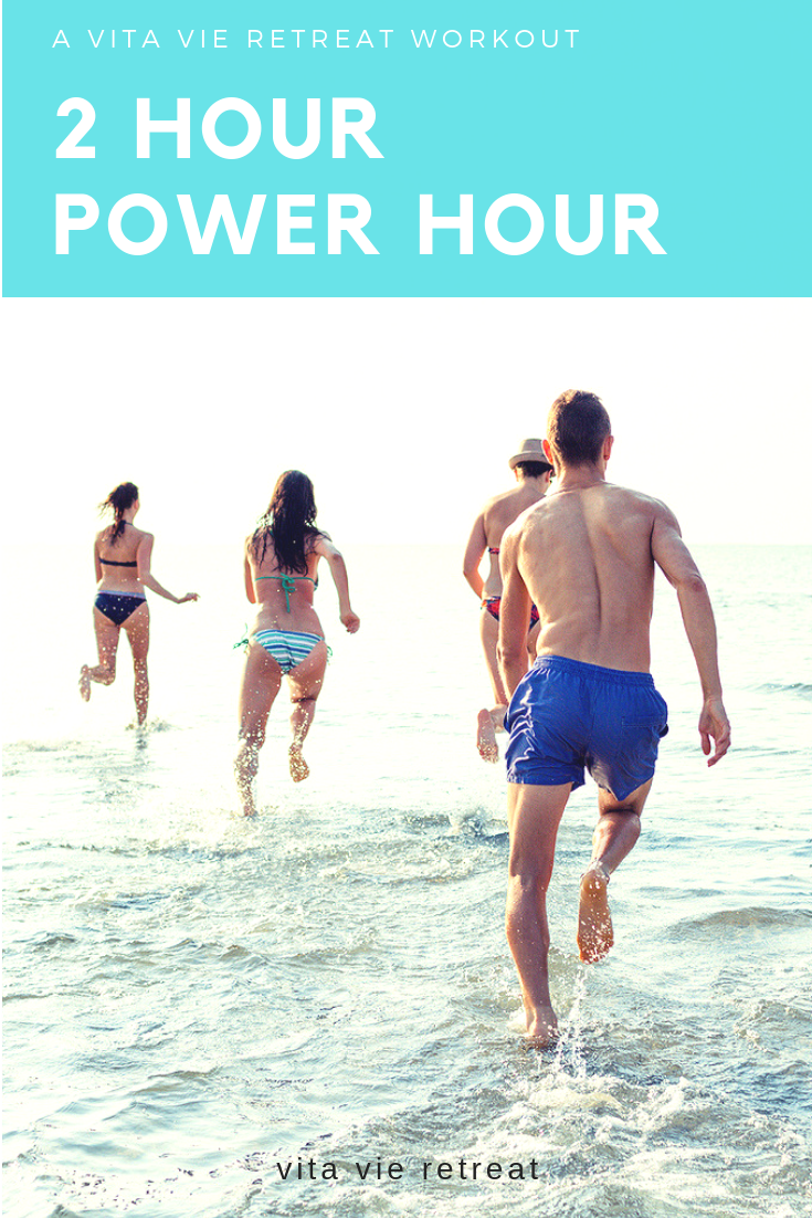 Clients run on the beach during the two hour power hour workout.