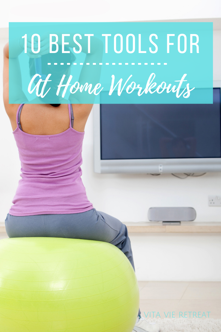 Woman using weights for at home workout.