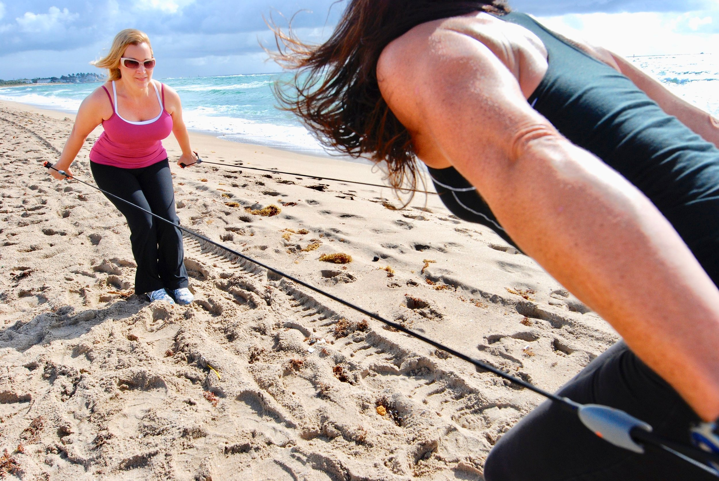 Ladies using resistance bands during their fitness retreat.