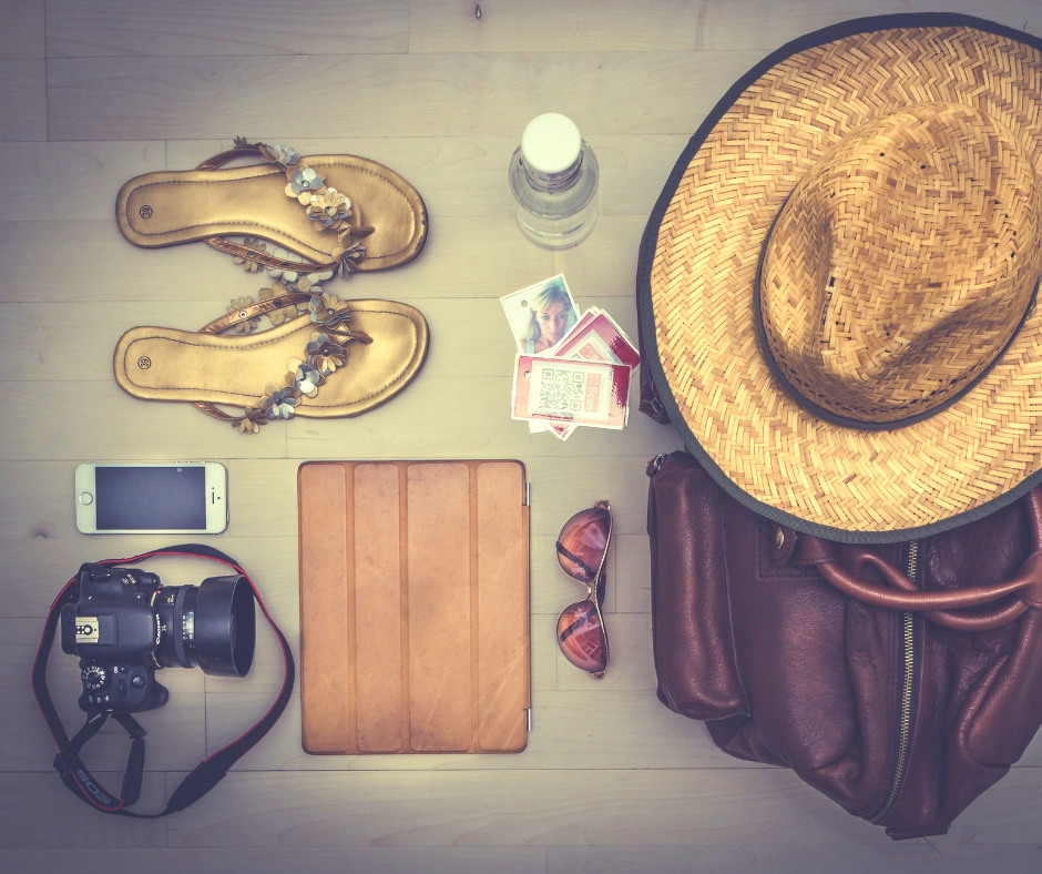 Items to pack for your fitness vacation like flip flops, hat, sun glasses and more.