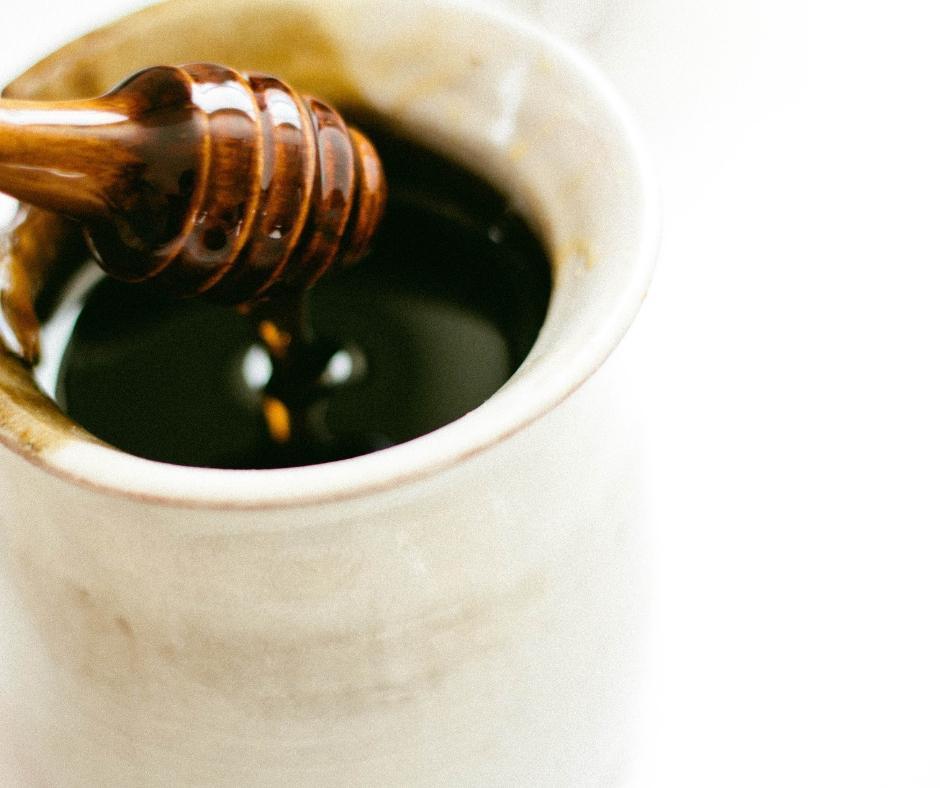 A bowl full of honey.