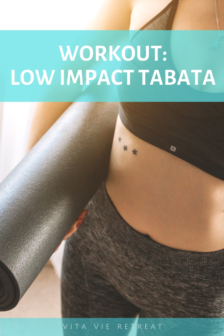 Woman with a mat getting ready for low impact tabata.