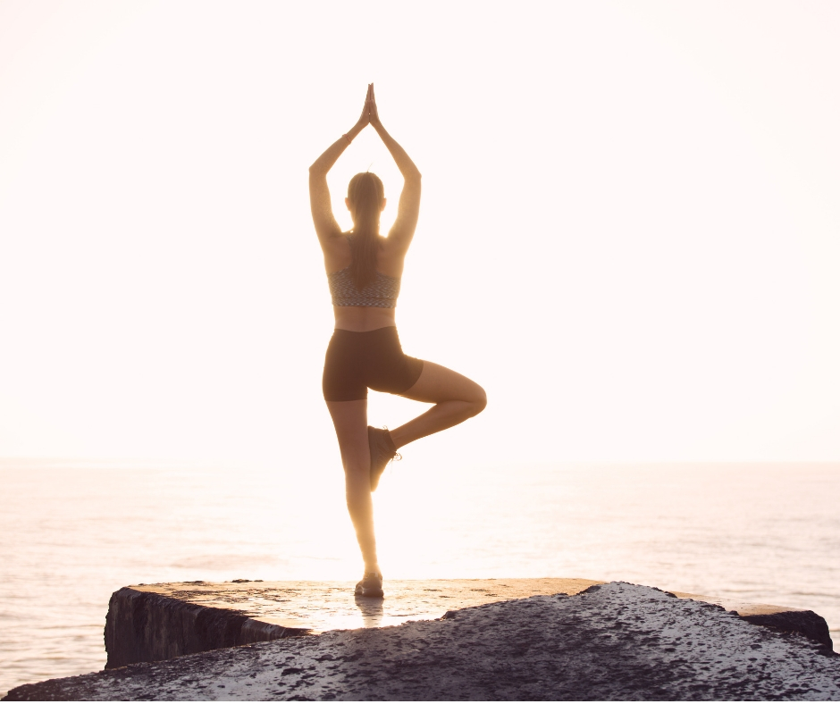 Woman practicing yoga for self care.