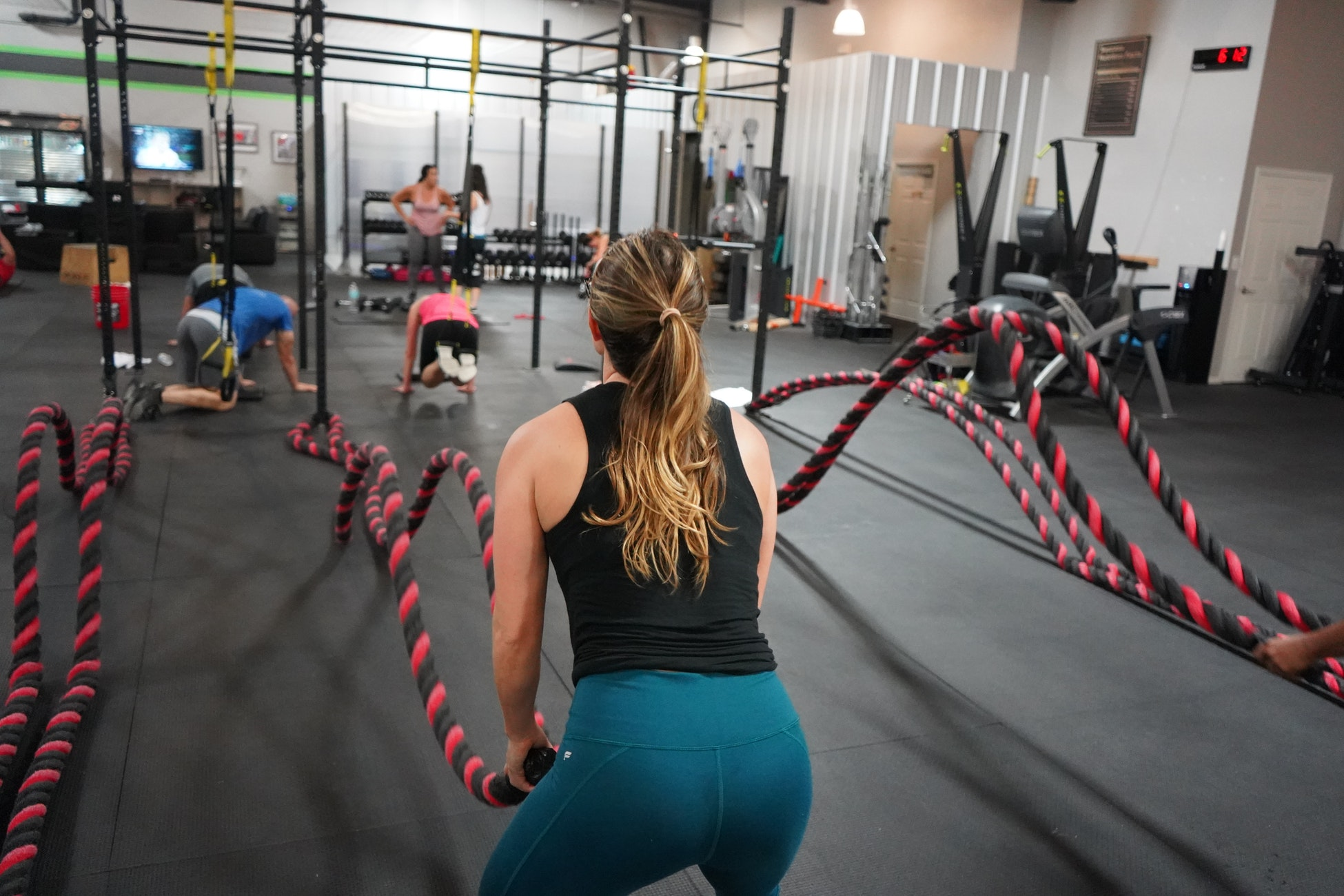 Girl trying ropes to improve her fitness level.