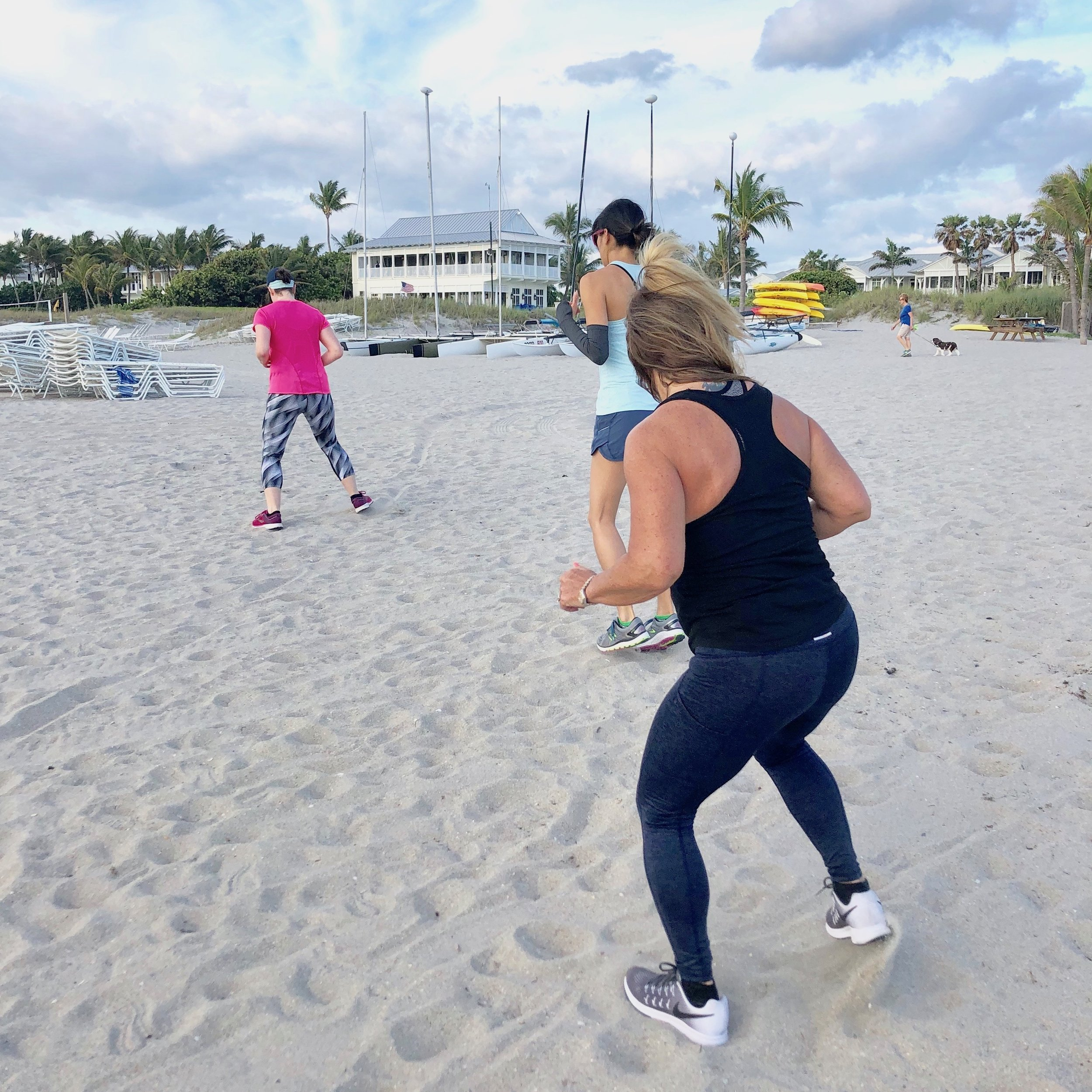 Vita boot camp guests do cardio at the beach.
