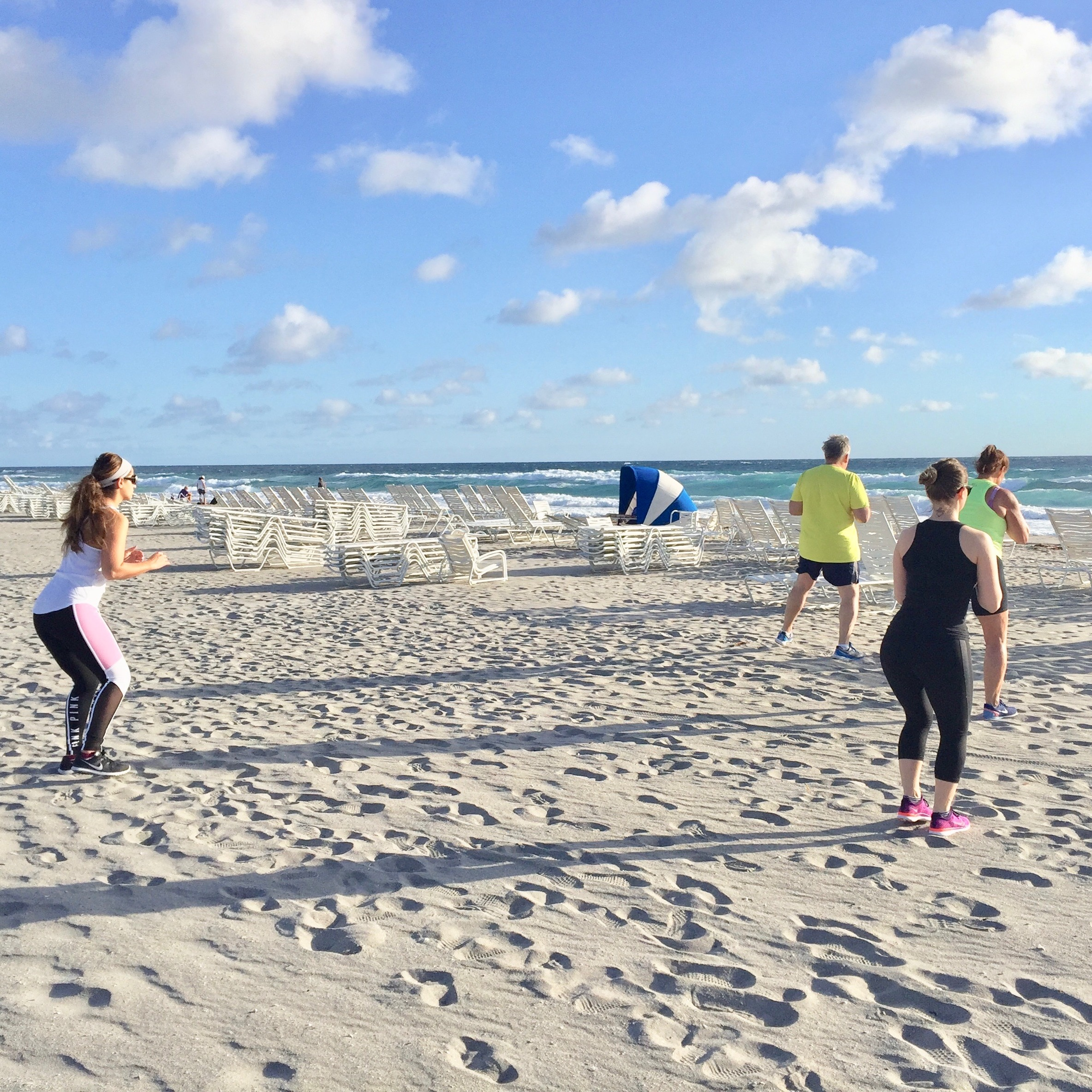 Drill work on the beach during weight loss boot camp class.