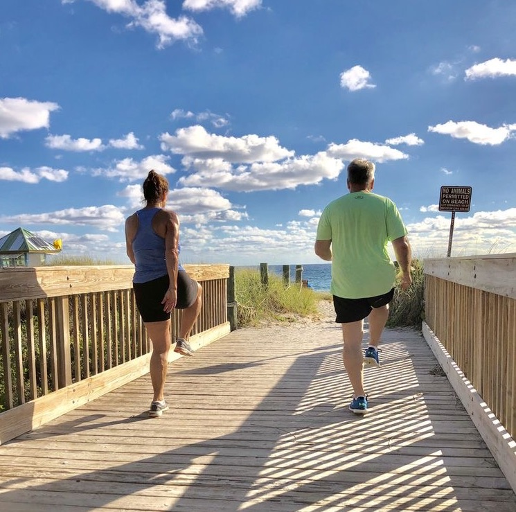 Weight loss retreat guests workout with ocean views.
