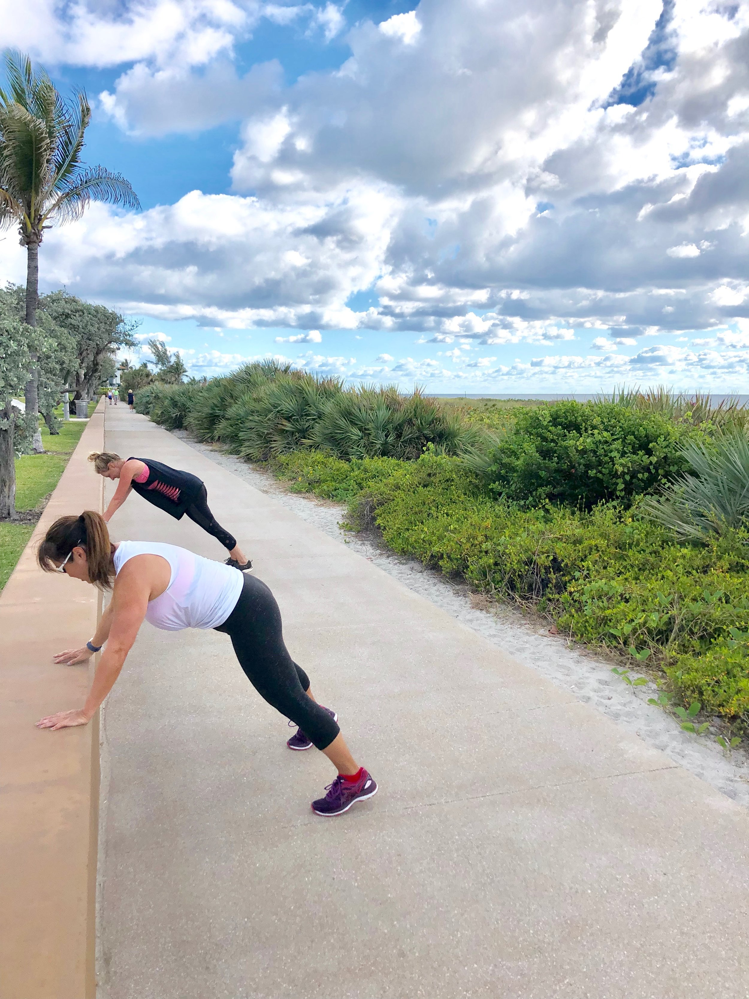 Plank jacks during fitness retreat workout.