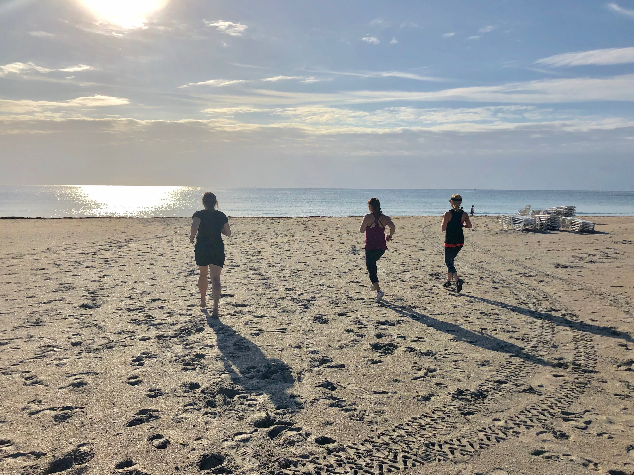 Running on the beach during fitness vacation.