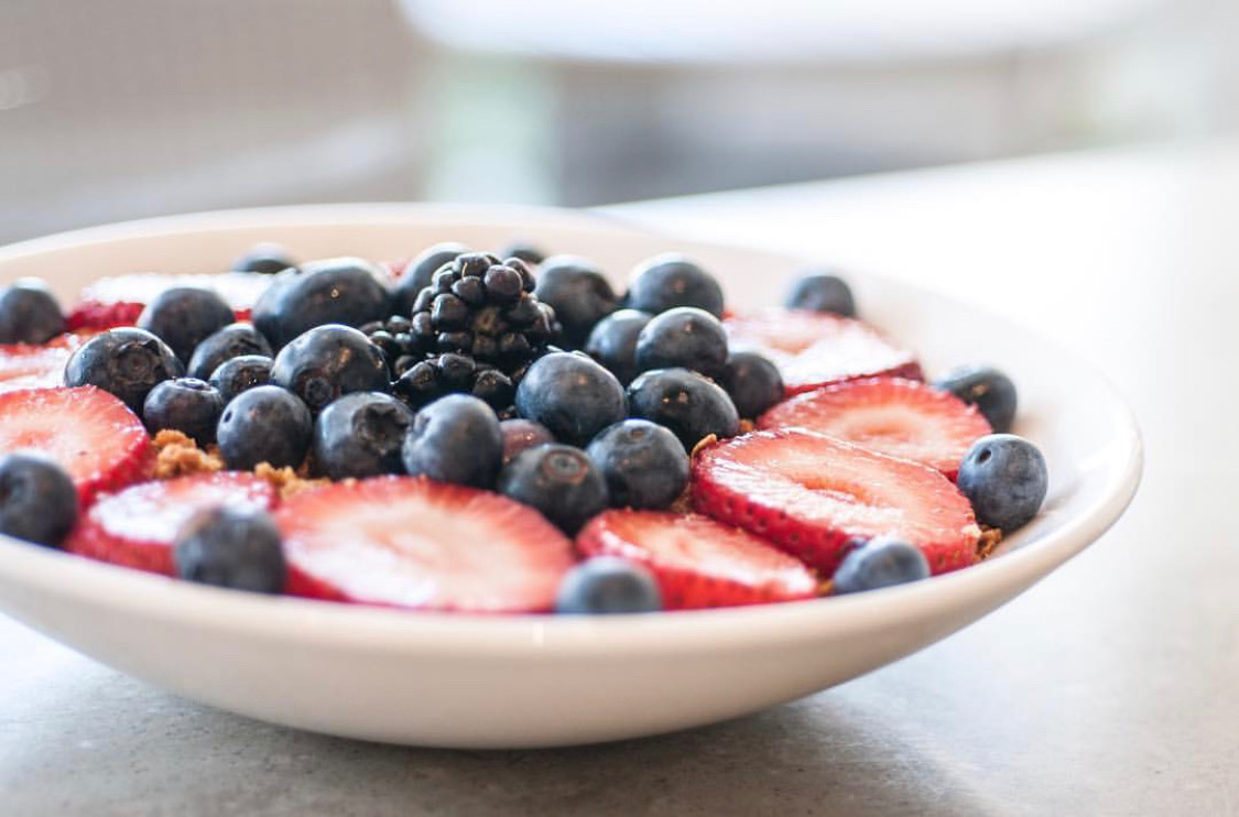 Fresh berry bowl is on the wellness retreat menu for a healthy breakfast.