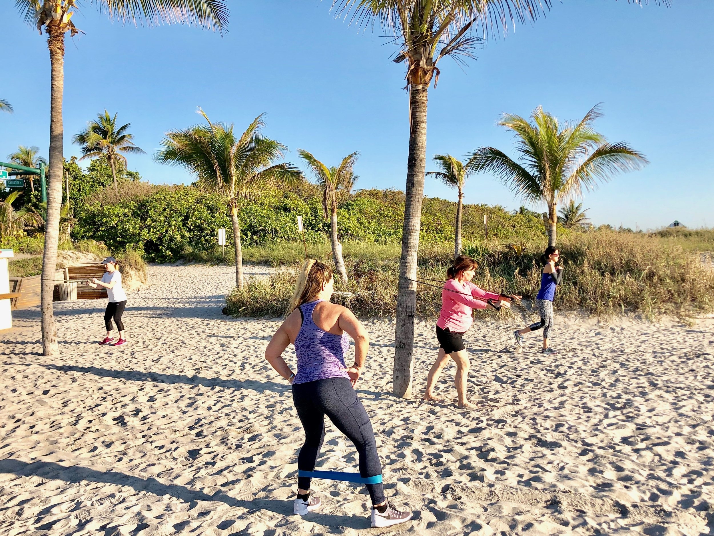 Boot cam guests tone up during beach strength session.