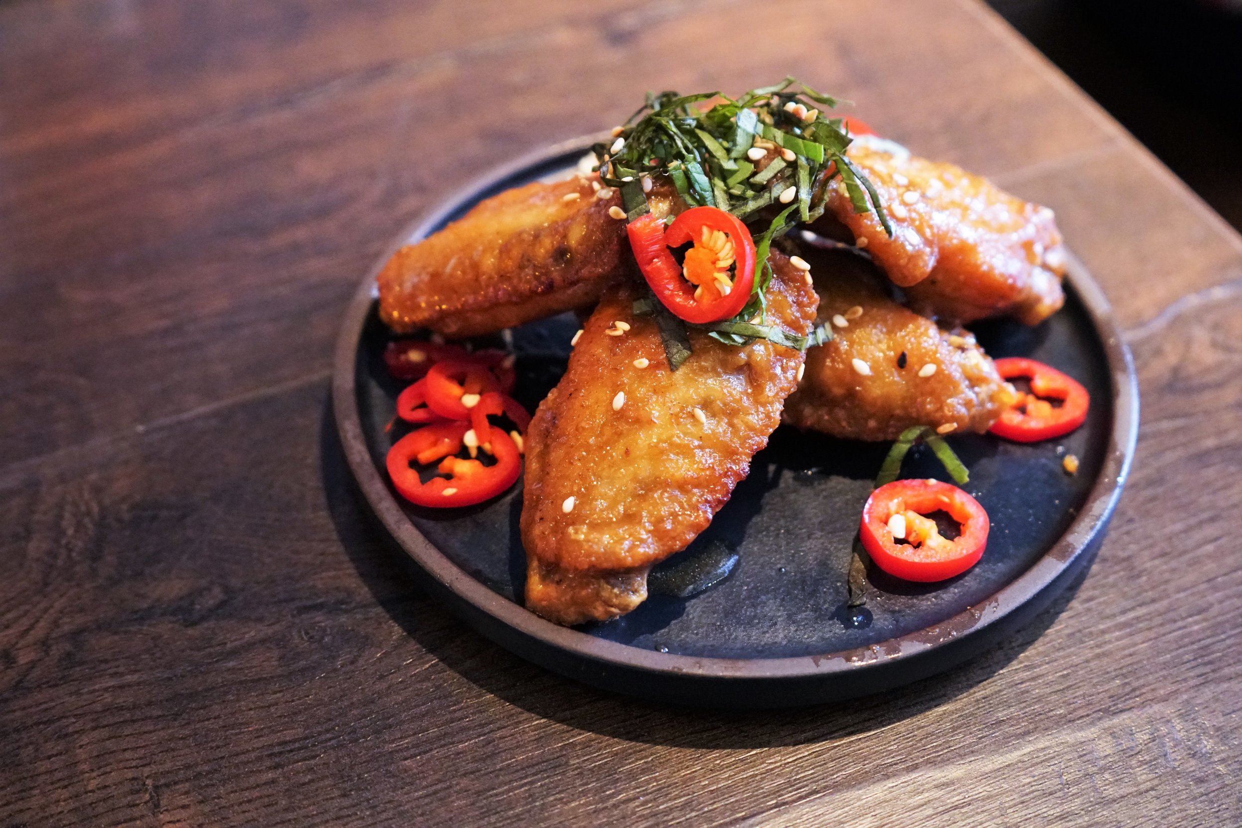 Three-Cup Glazed Chicken Wing at 886 in New York City