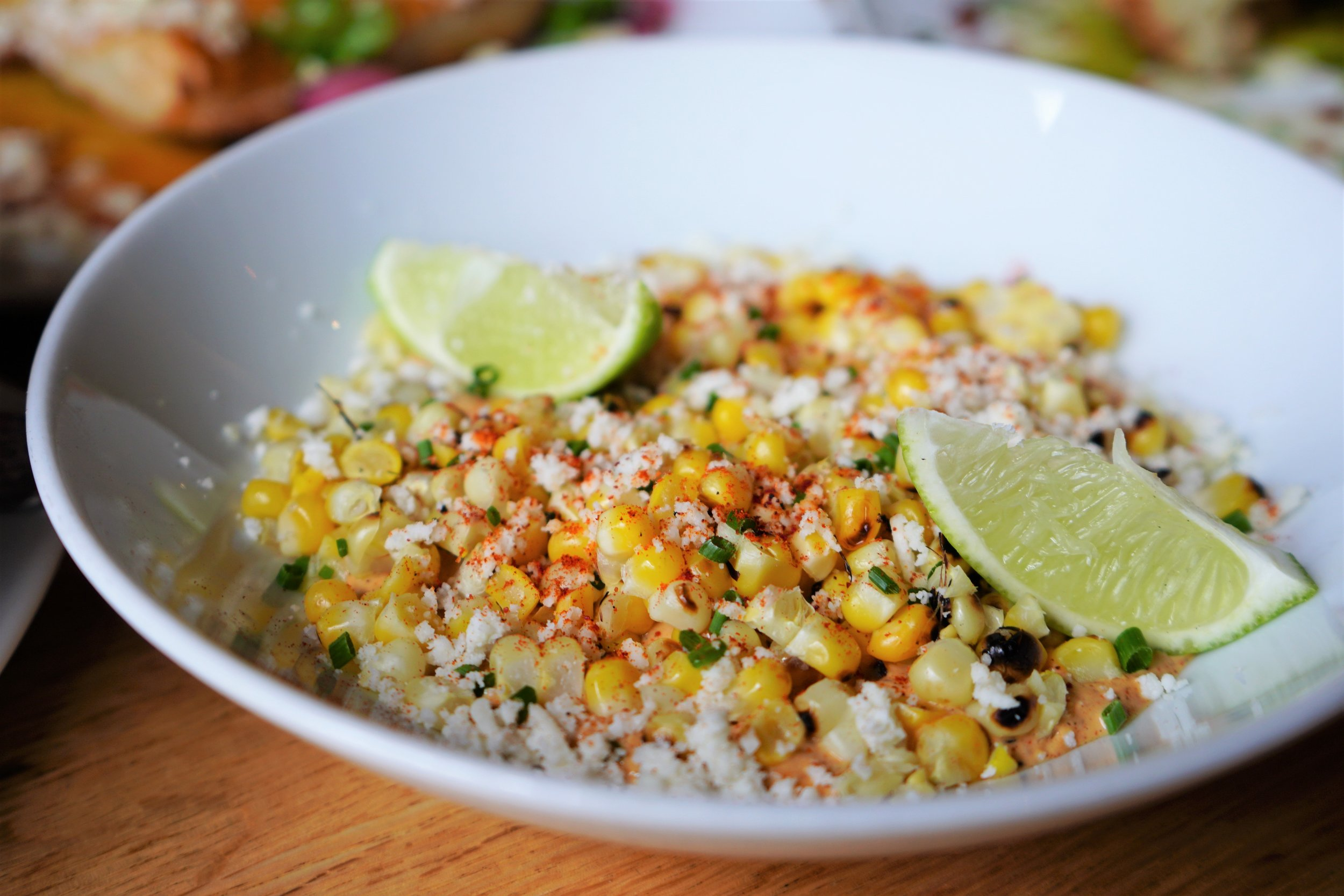 Grilled Corn with Cotija Cheese, Ancho Chili Creme, Lime, Guajillo at Tip Tap Room in Boston