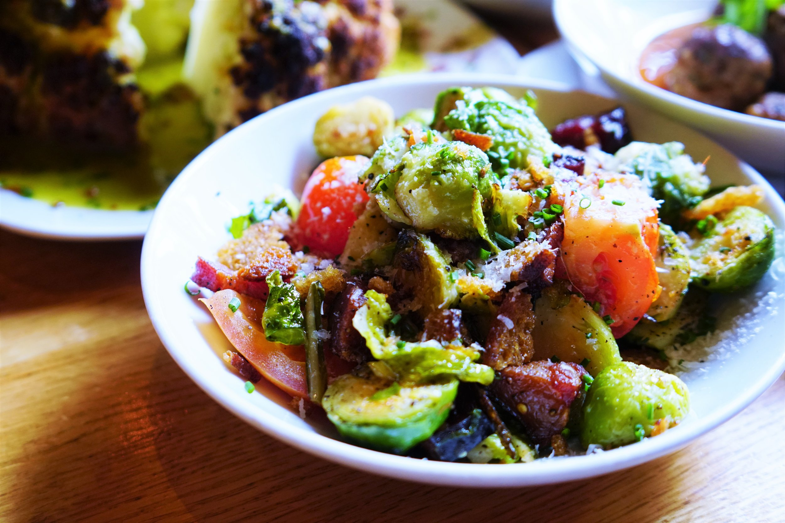 Brussels Sprouts with Basil, Lardon, Tomato, Garlic Crouton, and Pecorino Cheese at Tip Tap Room in Boston