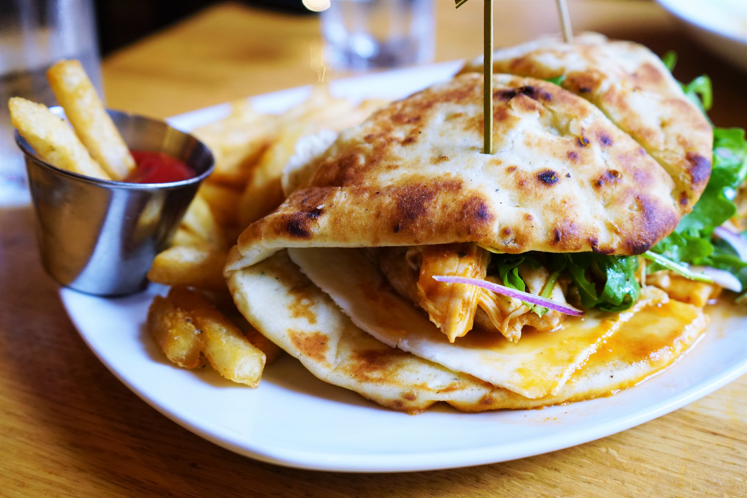 Chicken Tikka Sandwich with Masala Sauce, Red Onion, Arugula, Paneer, Garlic Naan, and Fries at Tip Tap Room in Boston