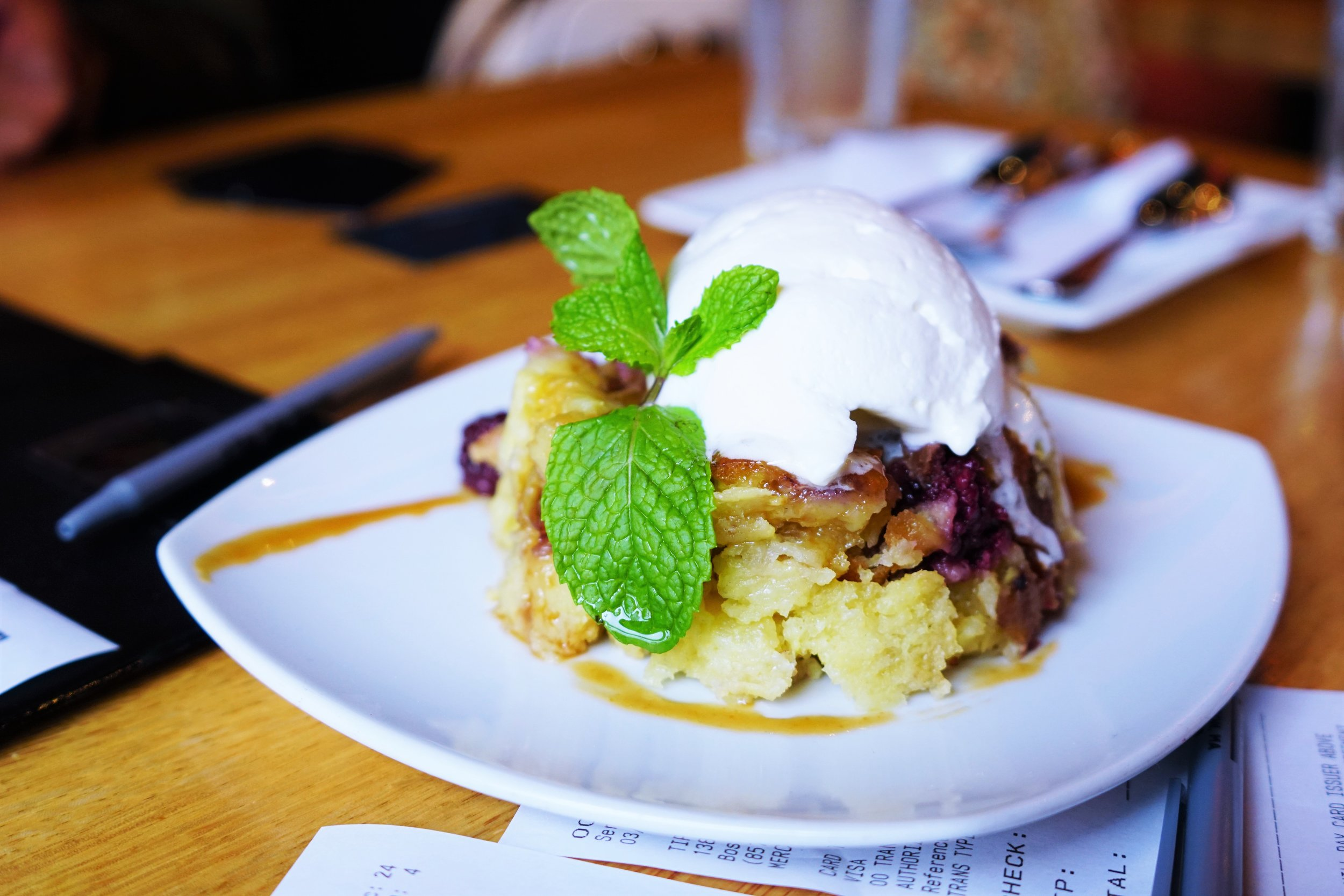 Blackberry Bread Pudding with Brioche, White Chocolate, Caramel, and Cinnamon Whipped Cream at Tip Tap Room in Boston