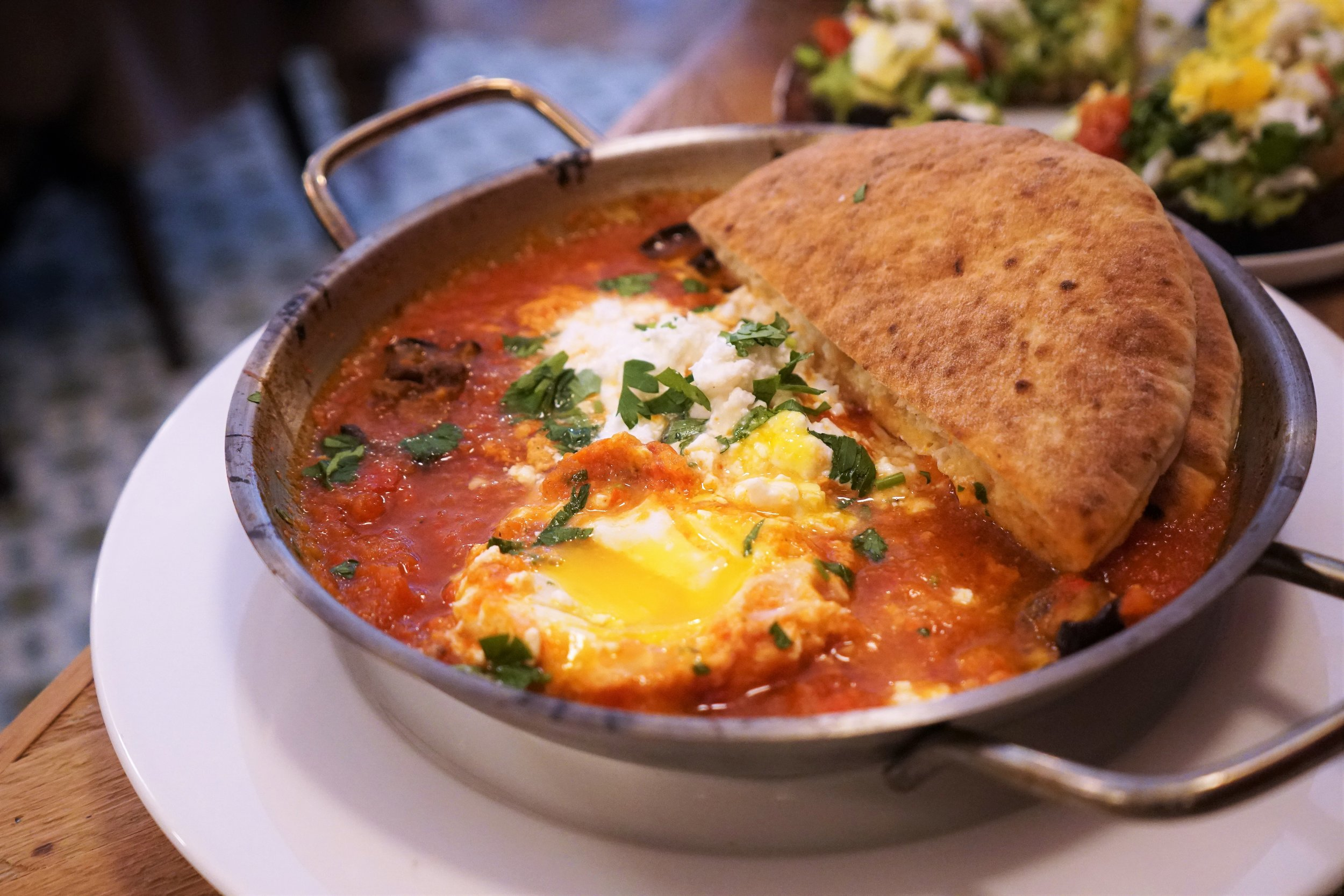 Shakshuka Eggs Baked in Spicy Tomato Red Pepper and Eggplant with Pita at Kubeh in New York City
