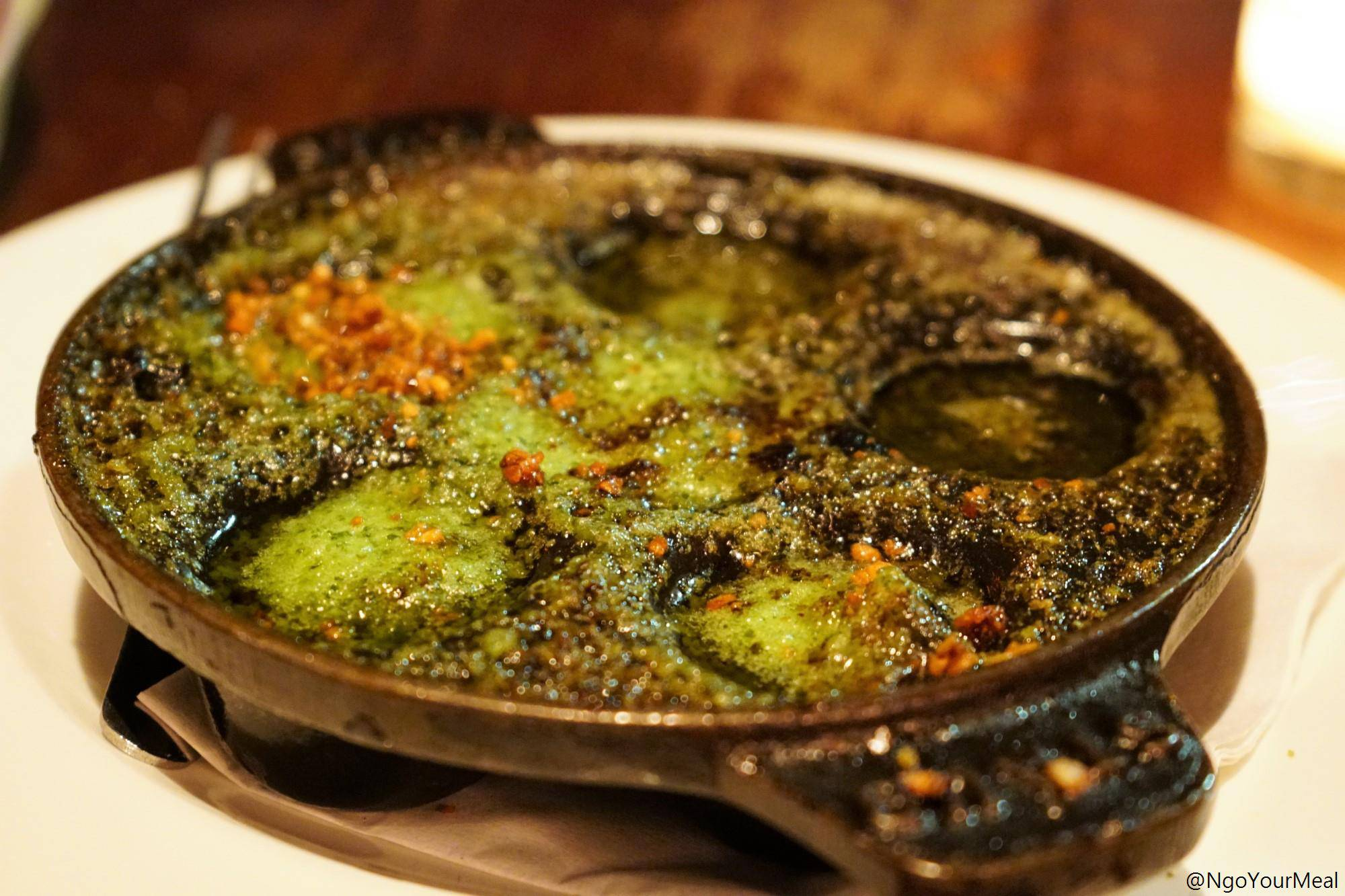 Escargots with Garlic, Parsley Butter, and Breadcrumbs at Gaslight in Boston