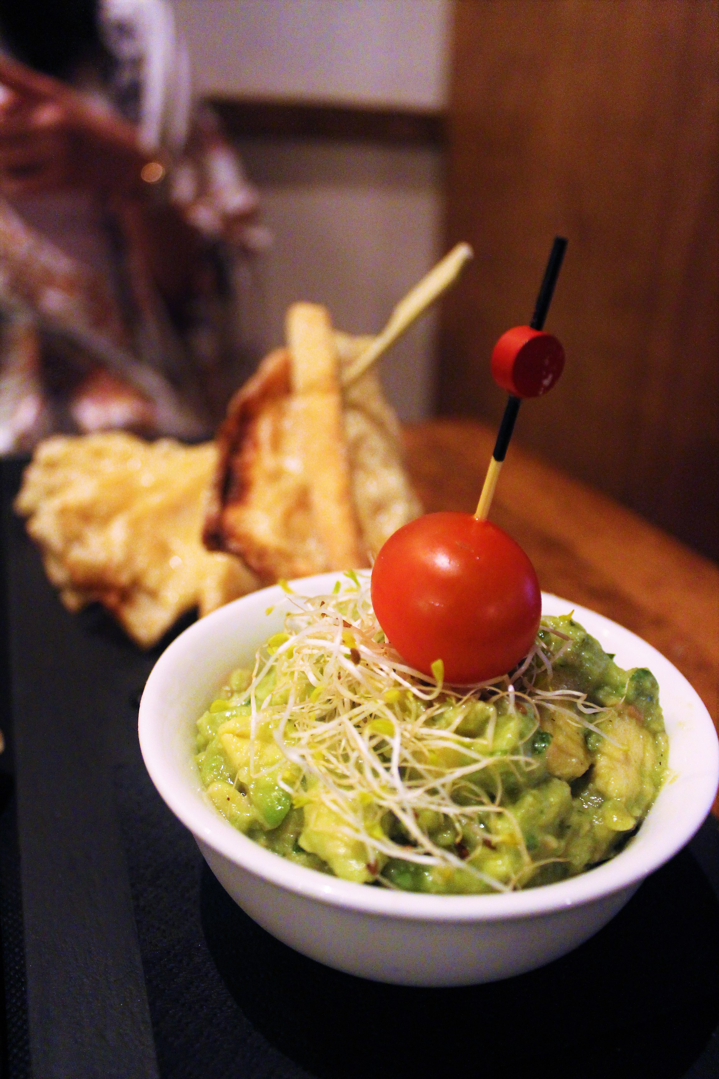 Guacamole, Coriander, and Mild Chili Pepper on Parmesan Base Torrada at Eldiset in Barcelona