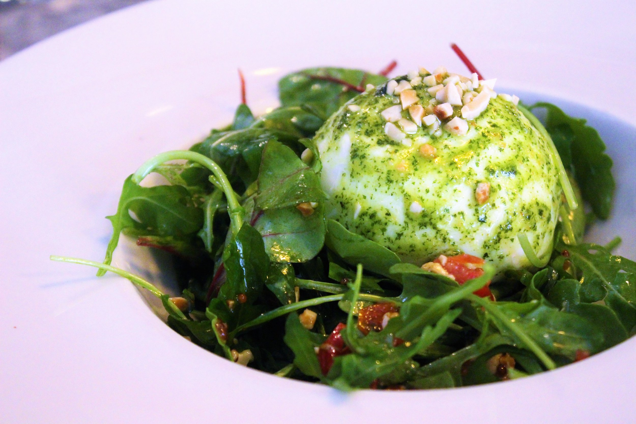 Buffalo Burrata, Arugula, Sun-Dried Tomatoes, Nuts, and Basil Pesto at Cera 23 in Barcelona