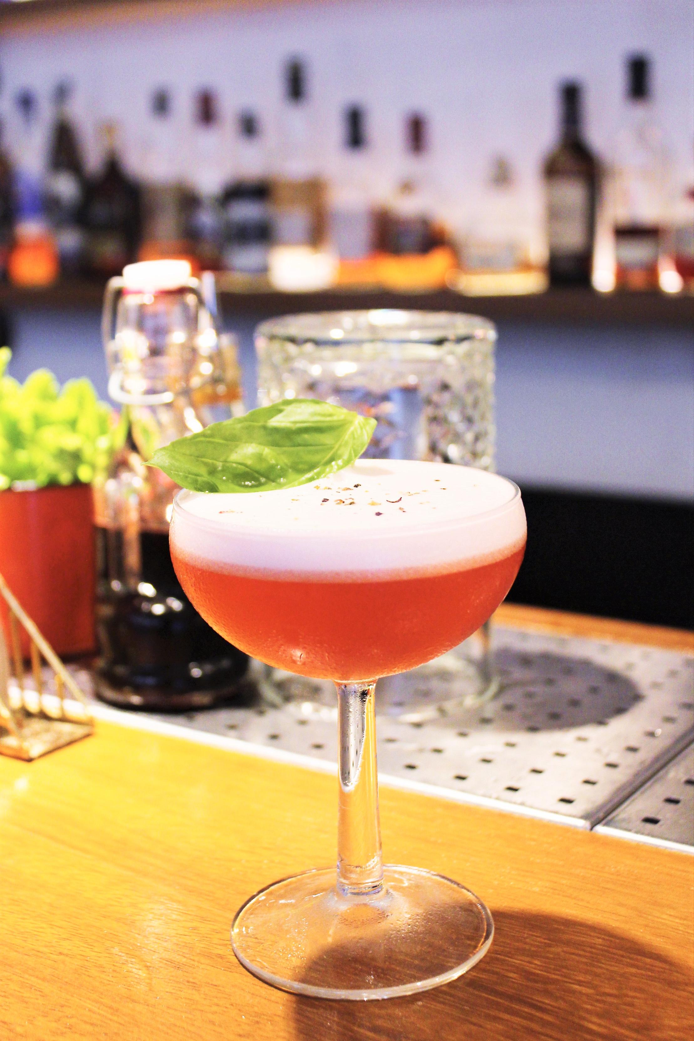 Basil Club Cocktail: Gin, Sour Raspberries, Basil, Fresh Lemon Juice, Ground Pepper at Pax 49 in Barcelona