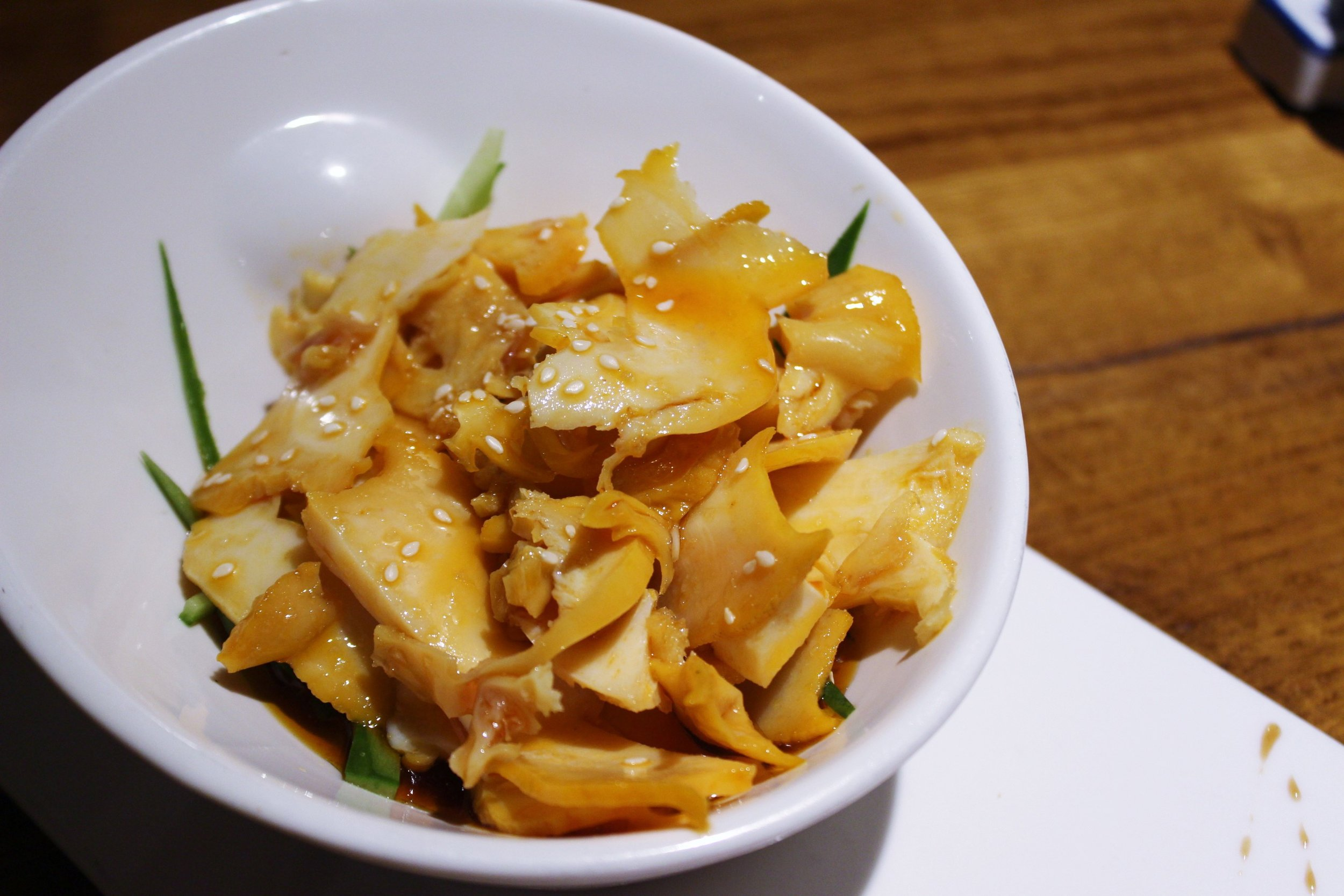 Thin Sliced Conch with Roasted Chili Vinaigrette at Szechuan Mountain House