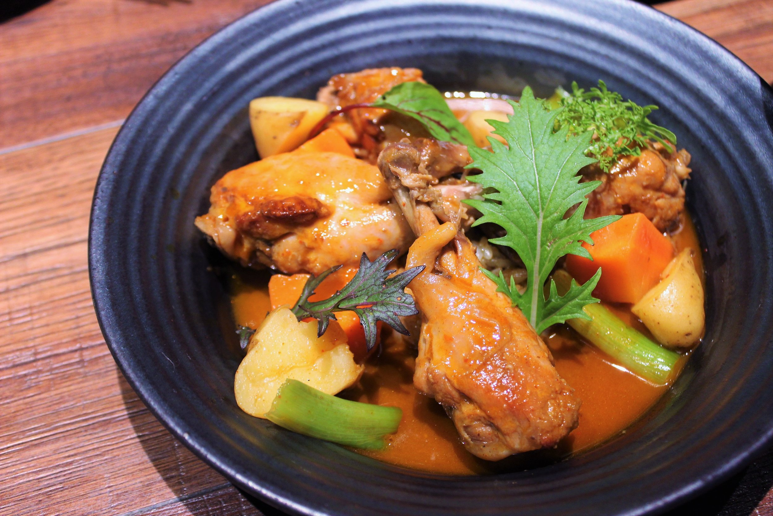 Gochujang Braised Chicken with Root Vegetables at Oiji in New York City