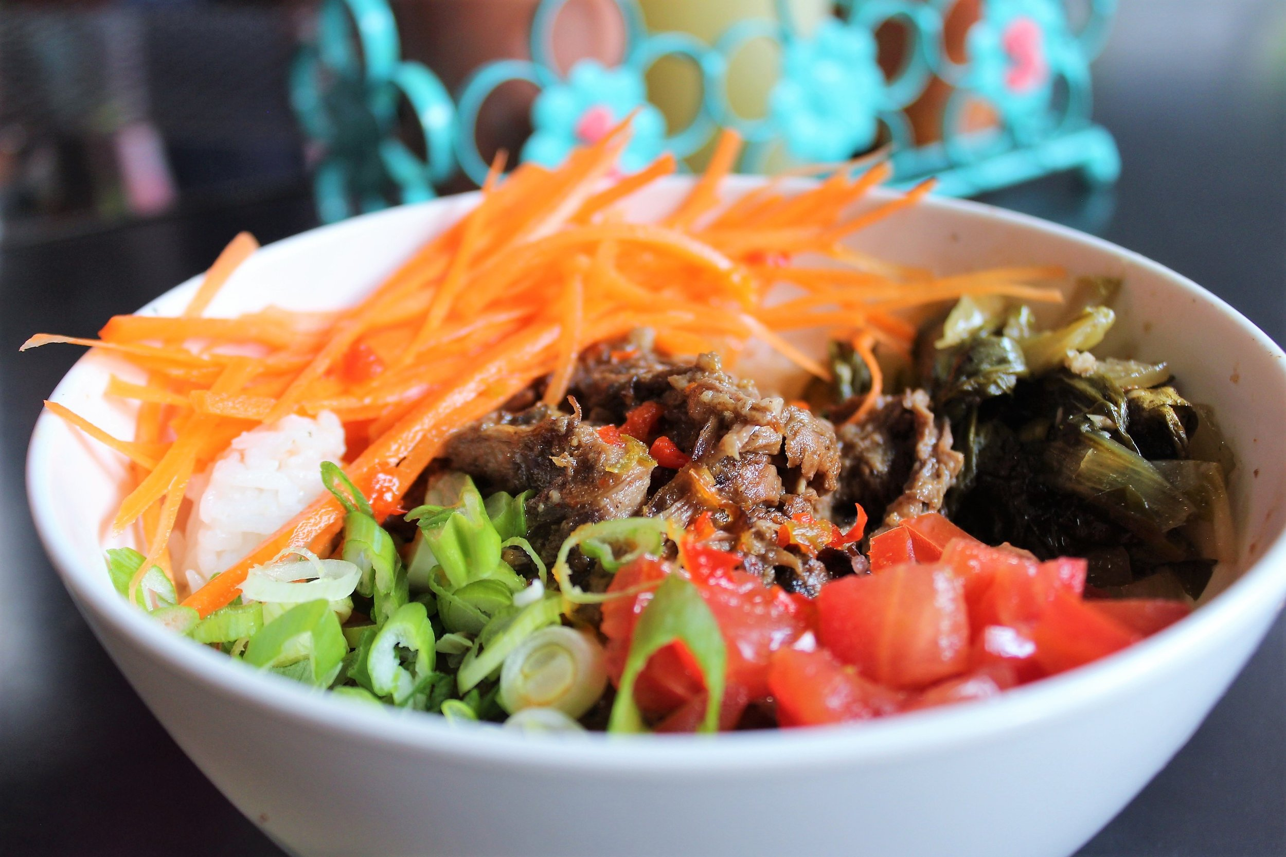 Sinigang Bowl with Short Rib, Garlic Fried Rice, Tomatoes, Carrots, and Bok Choy