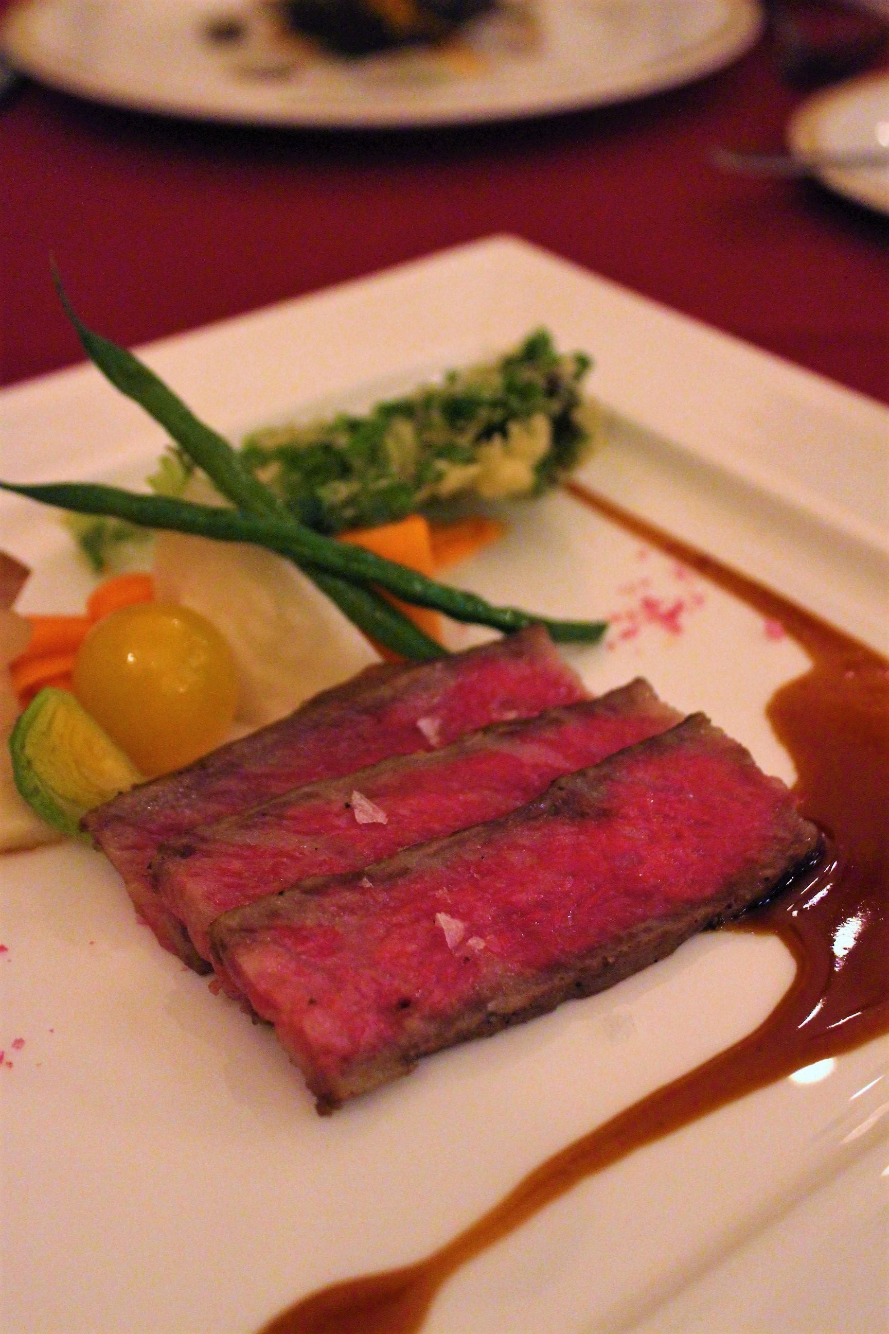 Roasted Kuroge Wagyu Beef topped with Madeira Sauce and Pink Crystal Salt at Magellan's in DisneySea, Tokyo, Japan