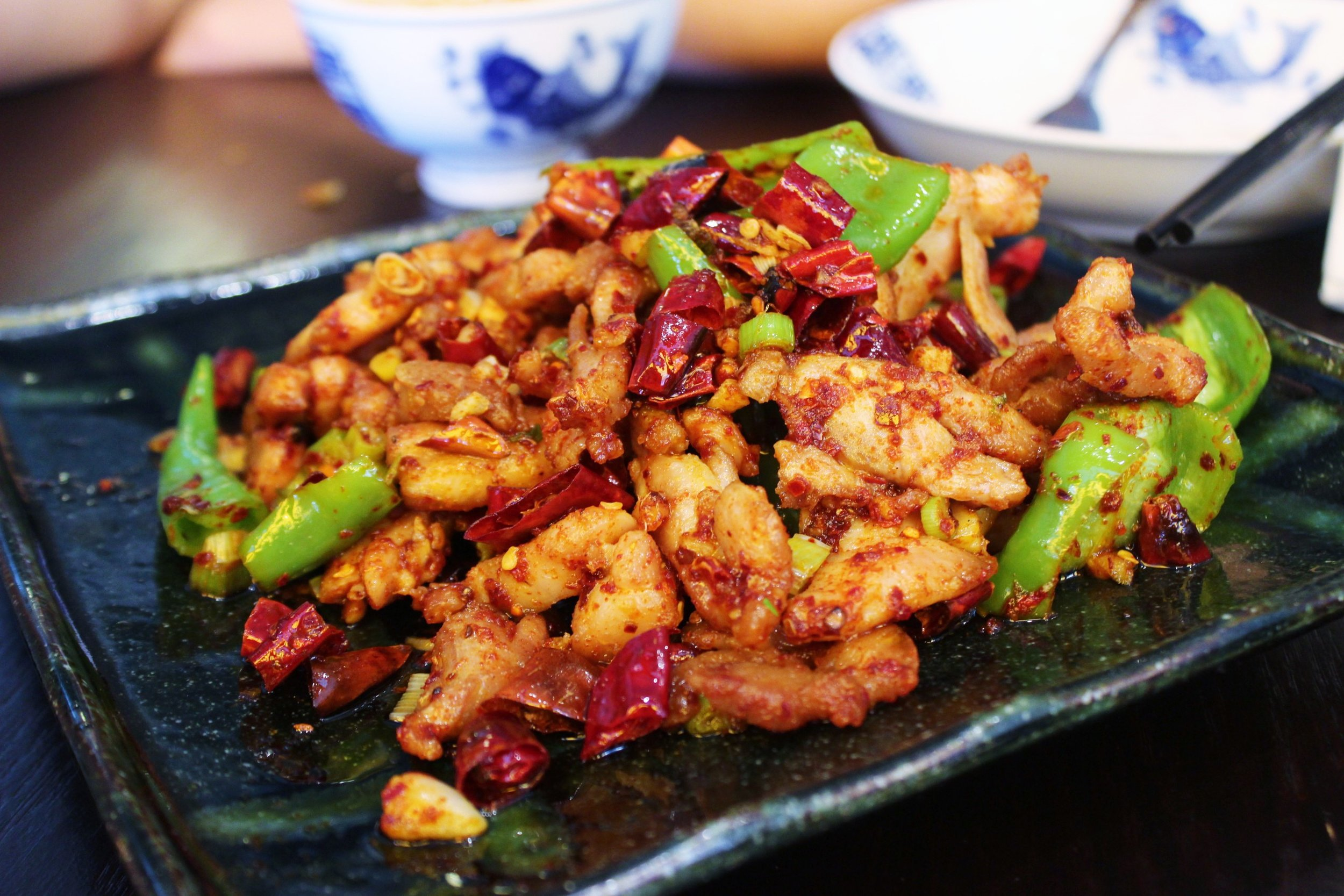 Three Pepper Chicken: Stir-friend with red and green chili peppers and peppercorn