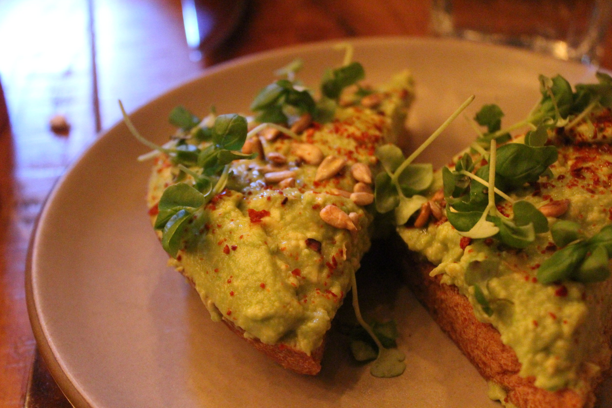 Avocado Toast (Homemade Wheat Bread, Aleppo Pepper, Lemon, Lebanese Olive Oil, Seeds and Sprouts, Basil)