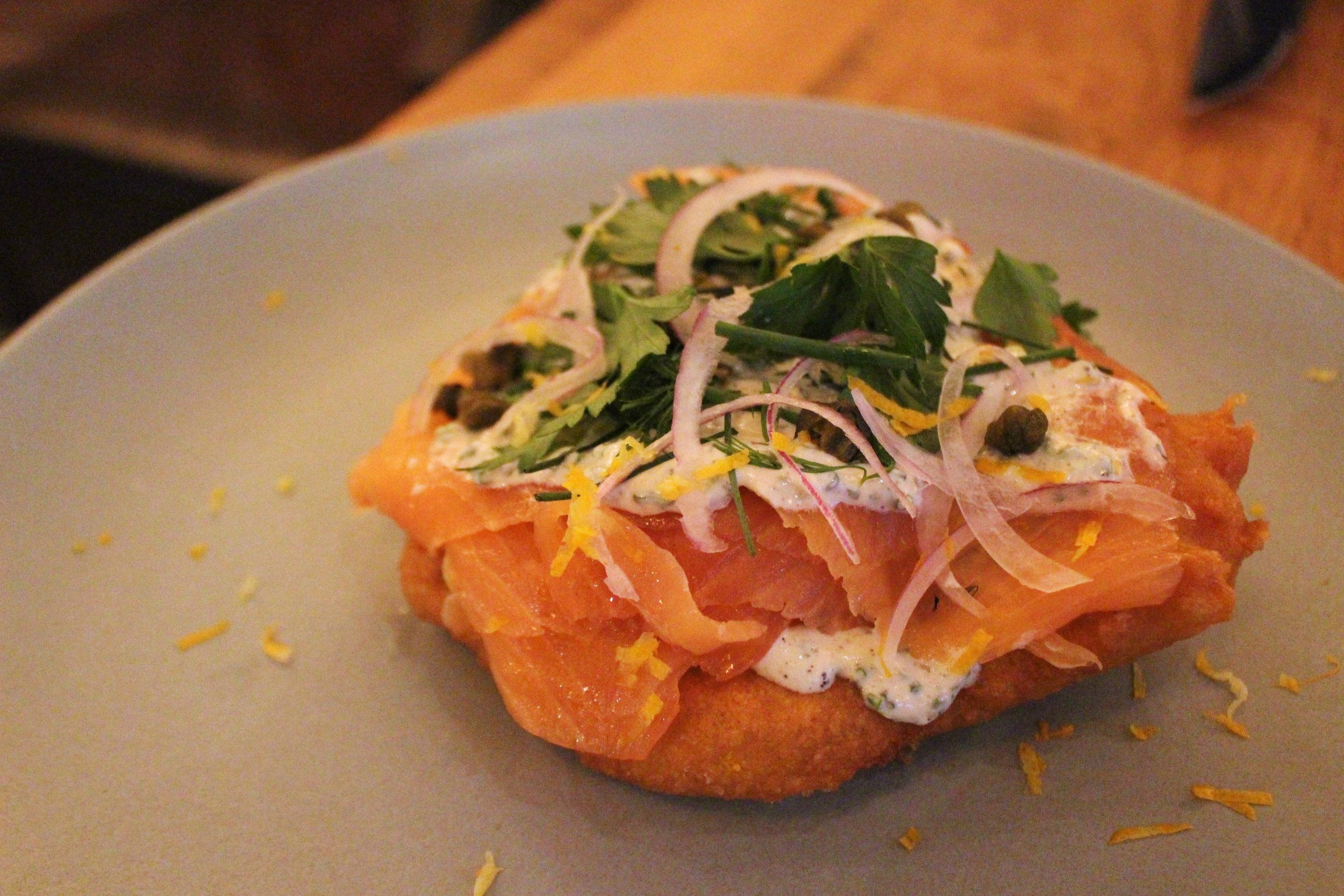 Hungarian Potato Fry Bread: Smoked Salmon, Kefir Ranch, Crispy Caper, Fresh Herbs at Covina