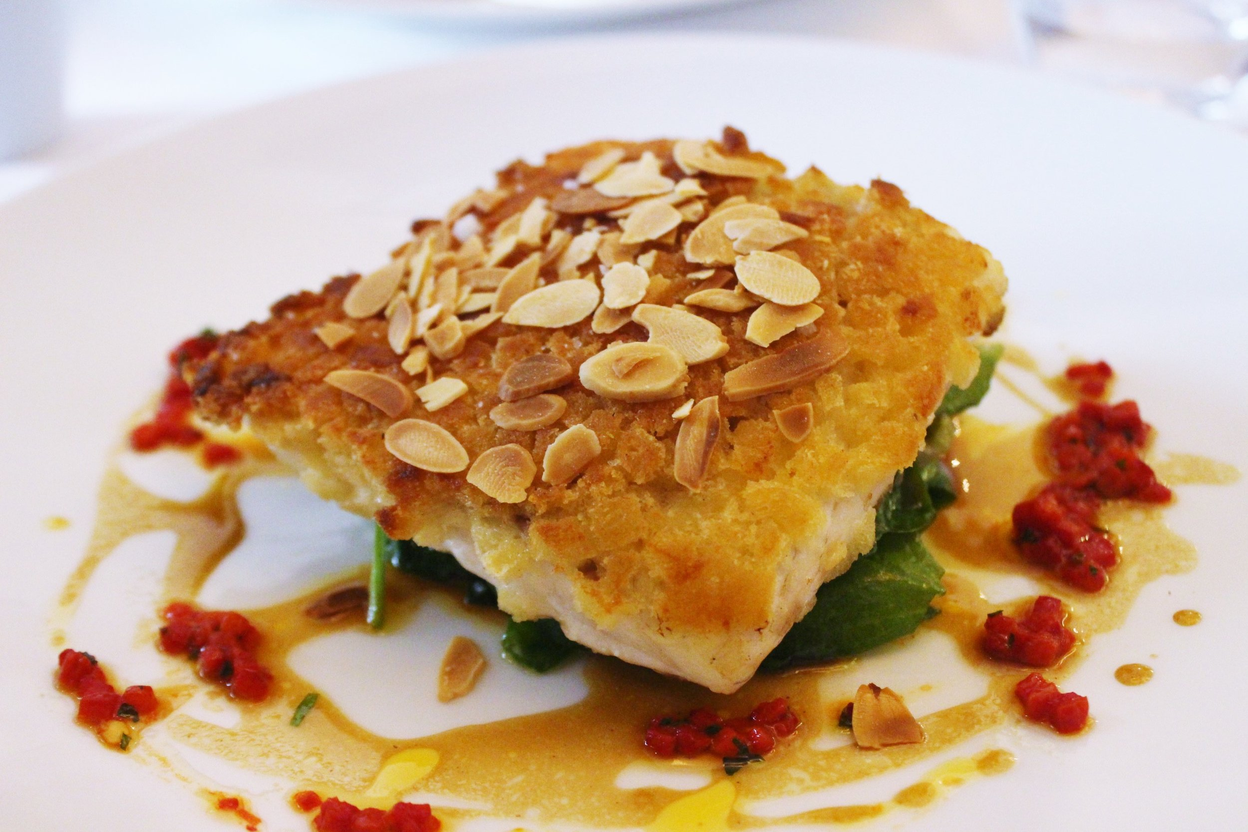 Supreme of Seabass, Crispy Almond Crust with Curried Oil and Peppers