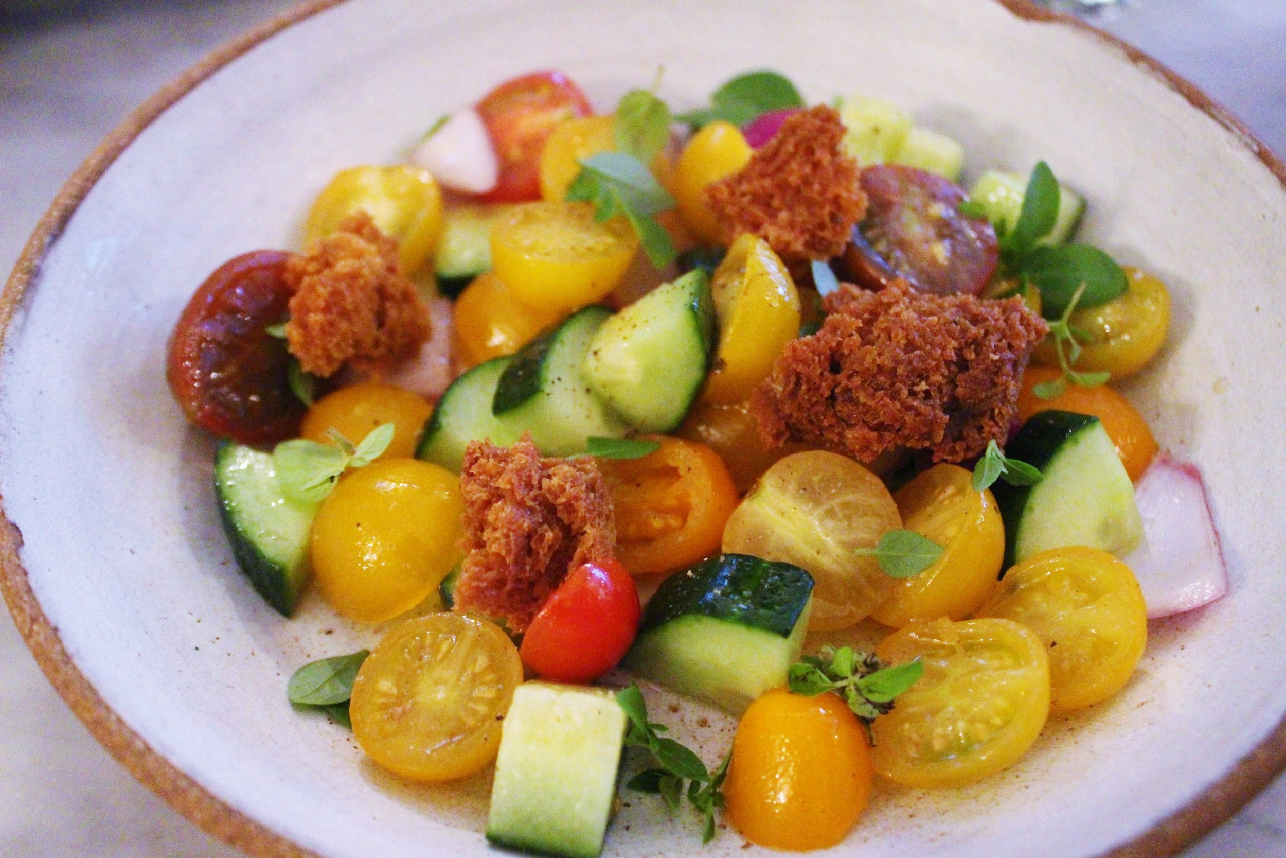 Salad of Cherry Tomatoes, Cucumbers, Fried Sourdough, and Red Onion at Ellsworth in Paris