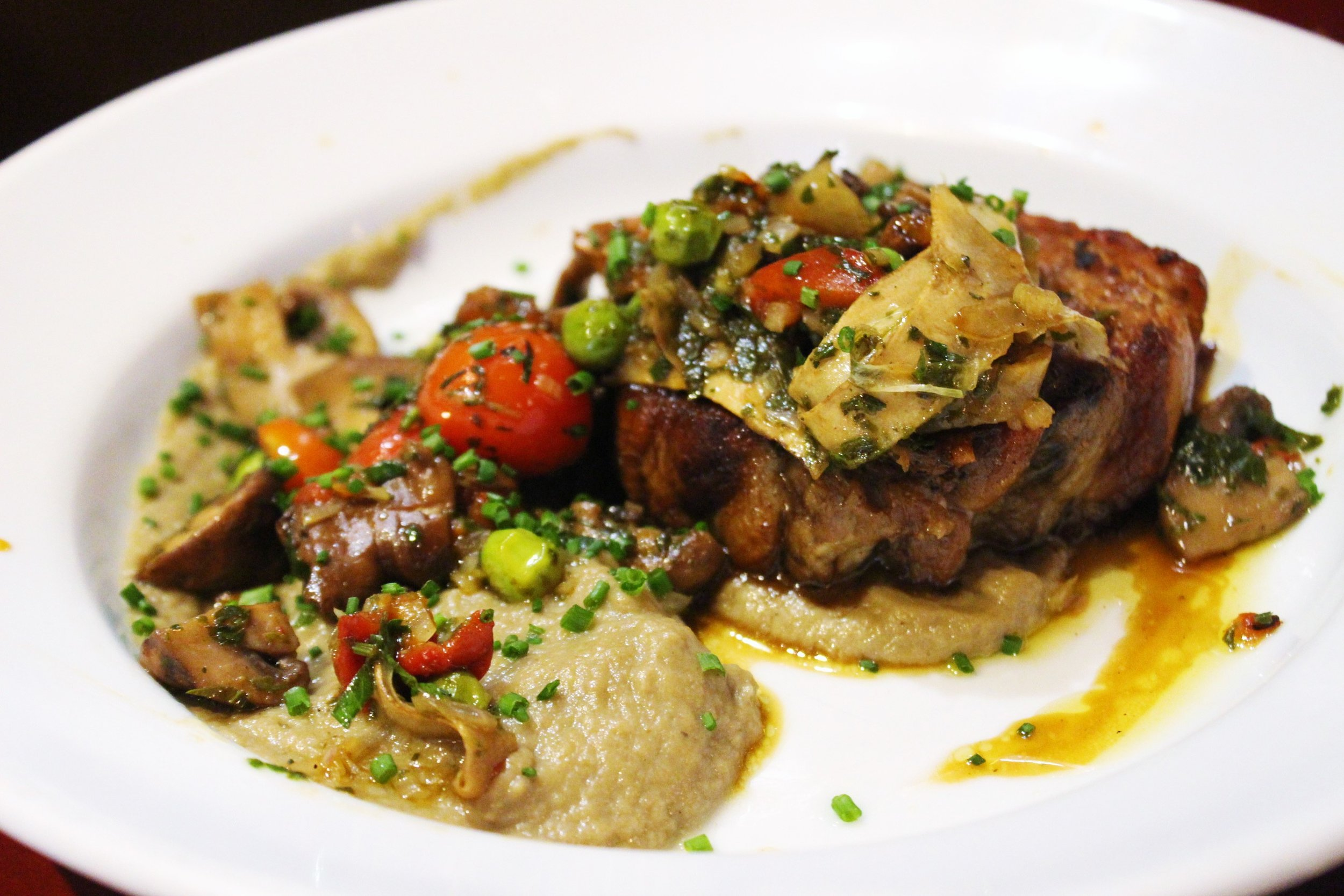 Veal Breast Confit, Eggplant Caviar, Fried Artichokes and Mushrooms at Juveniles in Paris